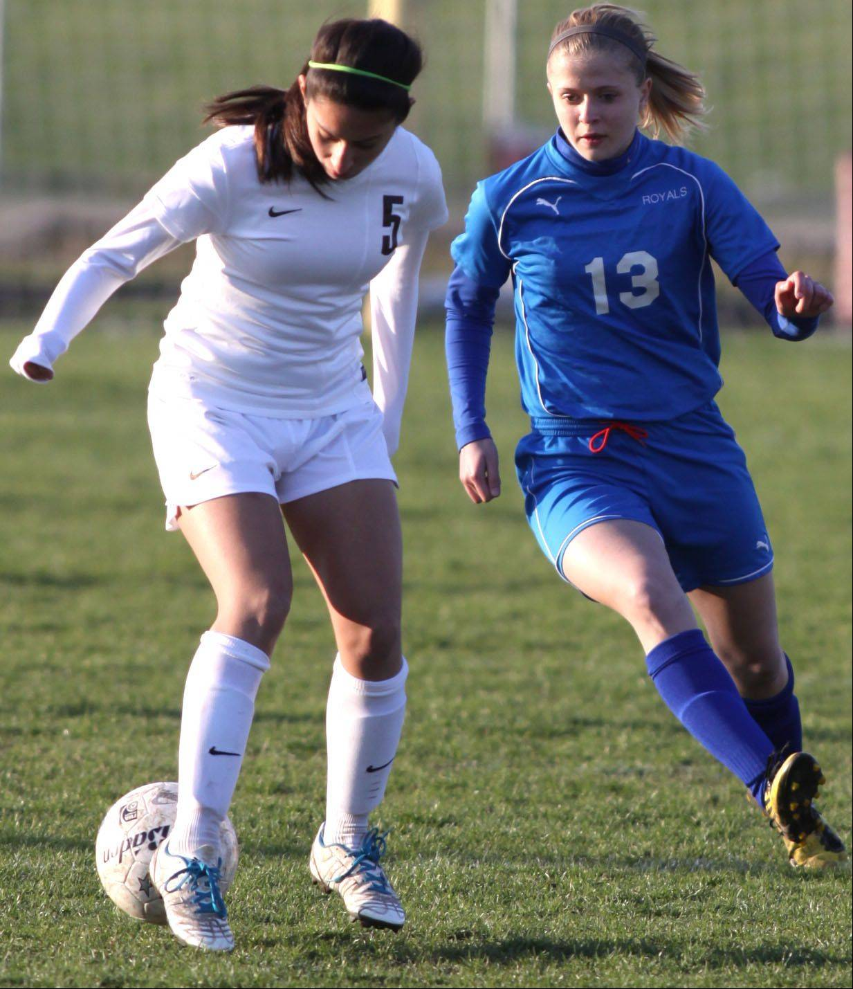 Larkin's Jaci Bridgers, right, and Elgin's Jenny Lopez battle for control of the ball at Memorial Field in Elgin on Wednesday evening.