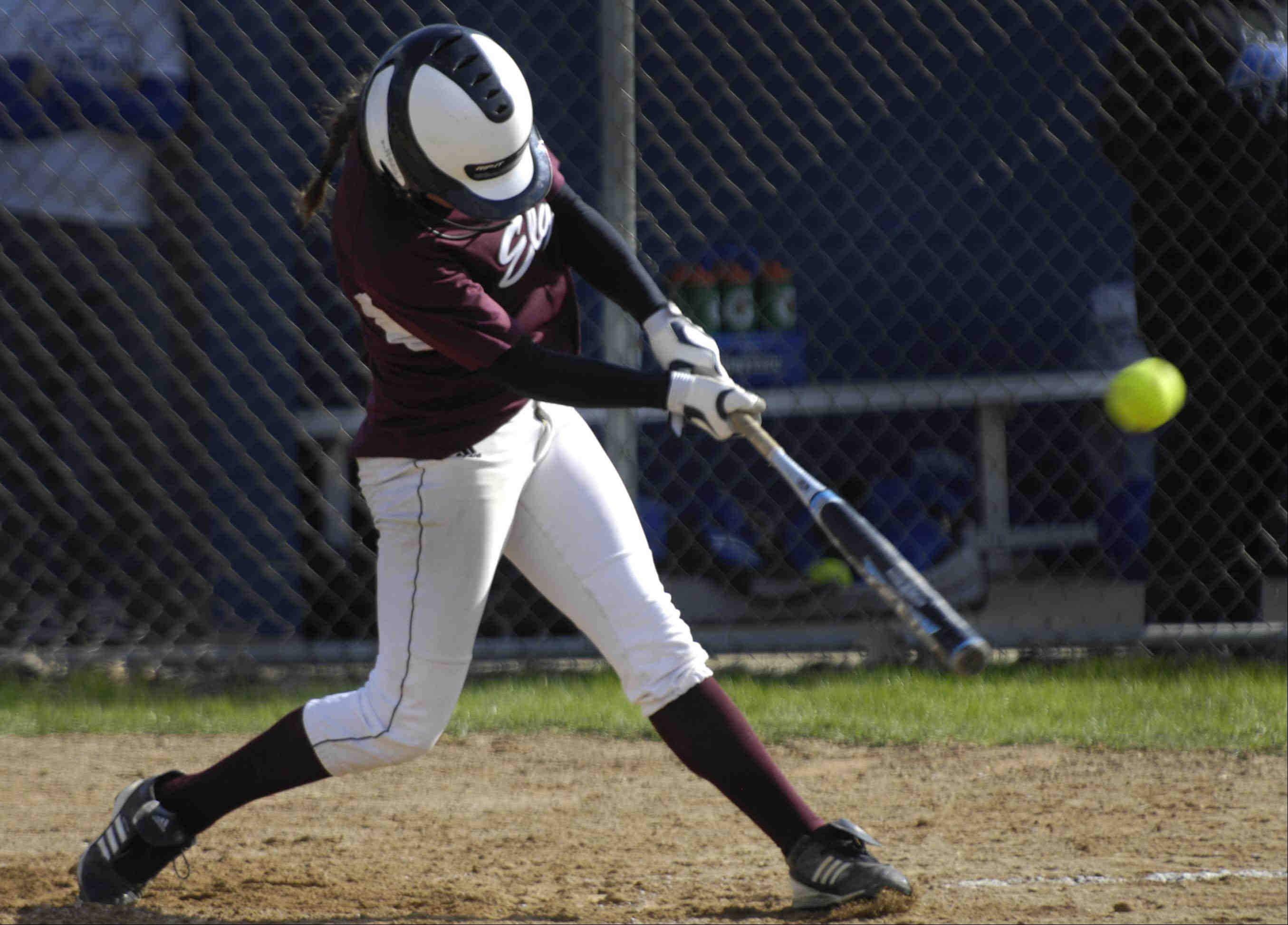 Elgin's Jennah Perryman hits the first of her two home runs against Larkin Wednesday in Elgin.