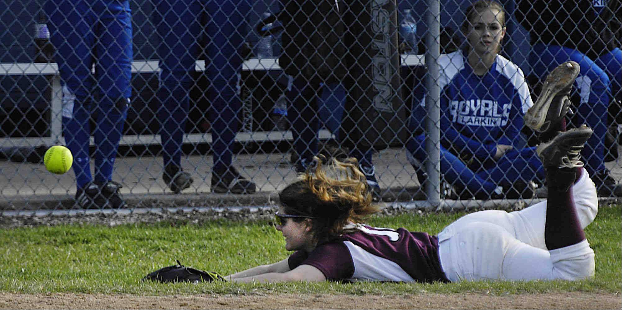 Elgin third baseman Anna Eckholm dives and misses a foul pop up by Larkin's Jaclyn Saurbaugh Wednesday in Elgin. Eckholm also hit a home run in the 10-0 win.