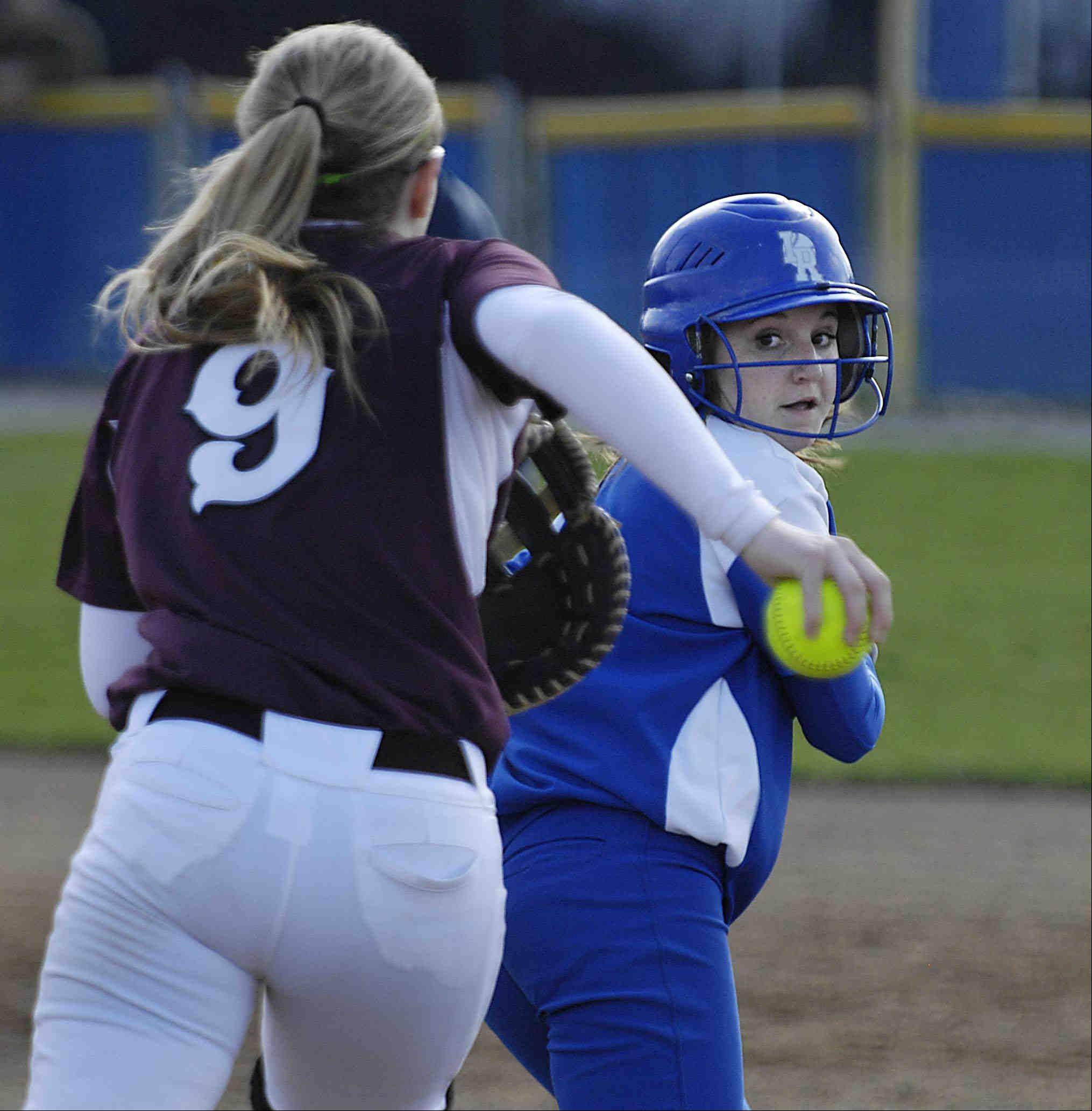 Elgin first baseman Monica Stockman chases Larkin's Beka Harrington all the way to second base before tagging her out Wednesday in Elgin.