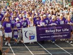 Cancer Survivors lead the first lap at Relay For Life.