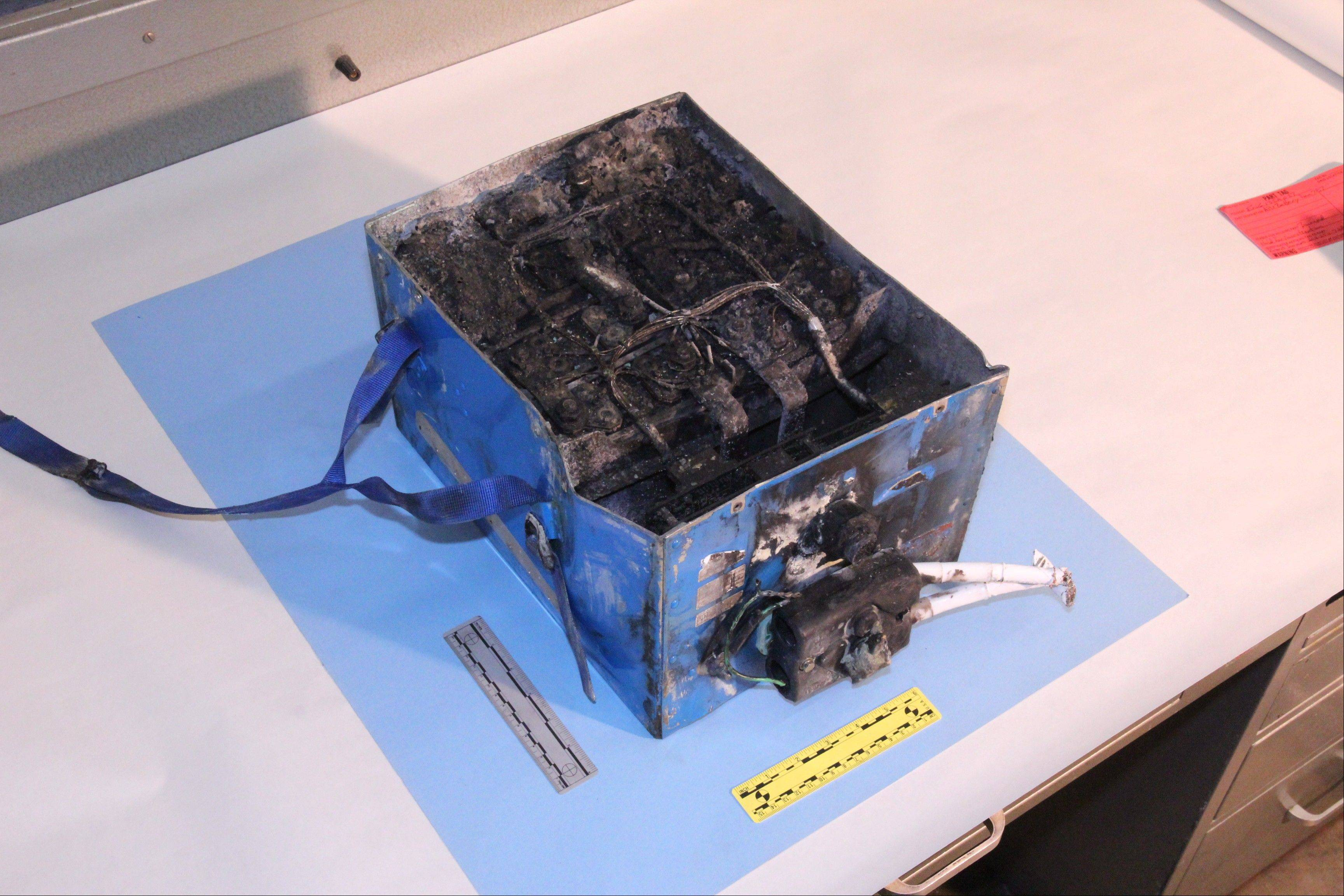 The burned auxiliary power unit battery from a JAL Boeing 787 that caught fire on Jan. 7, 2013, at Boston�s Logan International Airport.