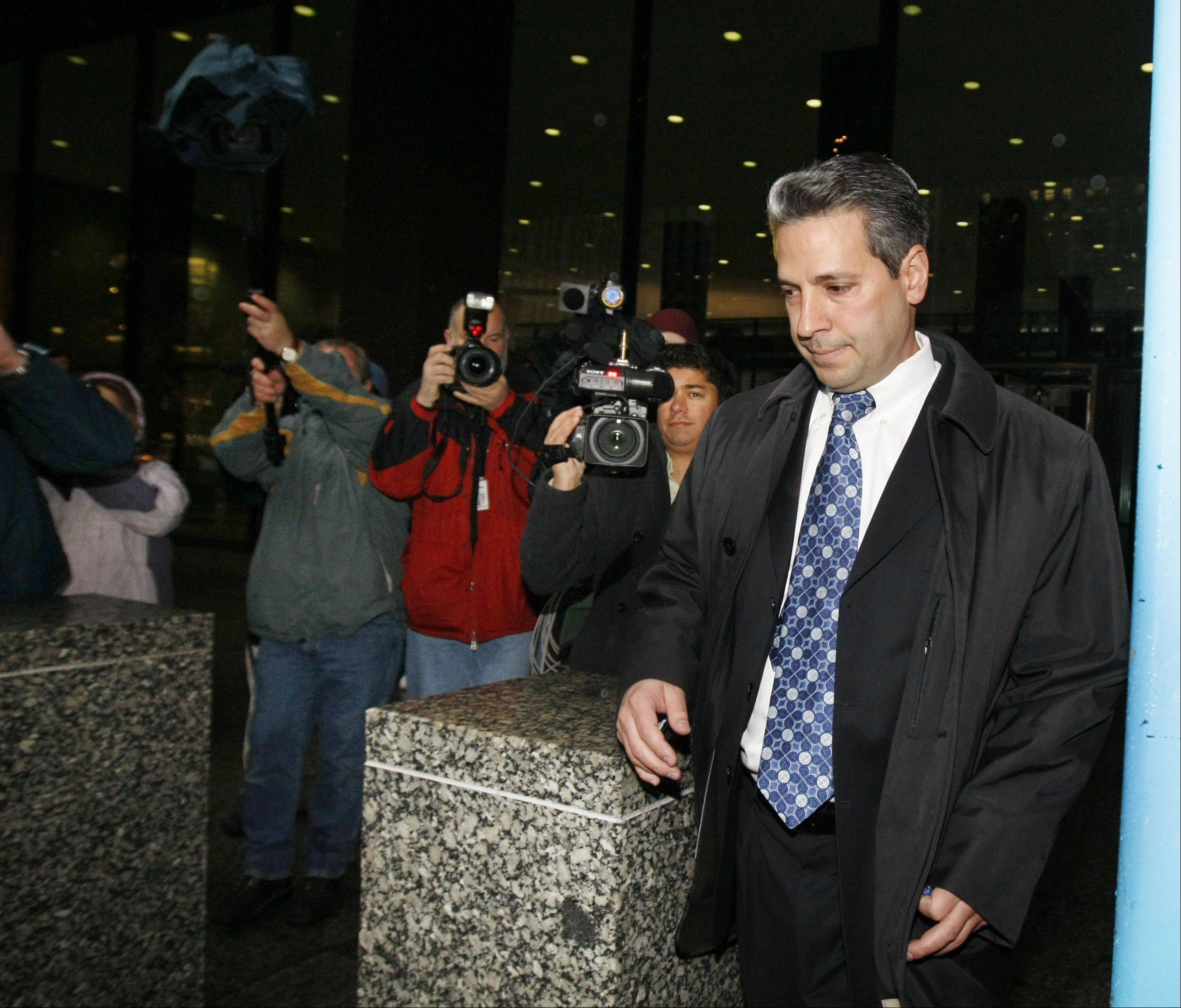 John Harris, right, chief of staff for Illinois Governor Rod Blagojevich, leaves the Dirksen Federal Building in Chicago Tuesday, Dec. 9, 2008 after he was arrested on corruption charges.