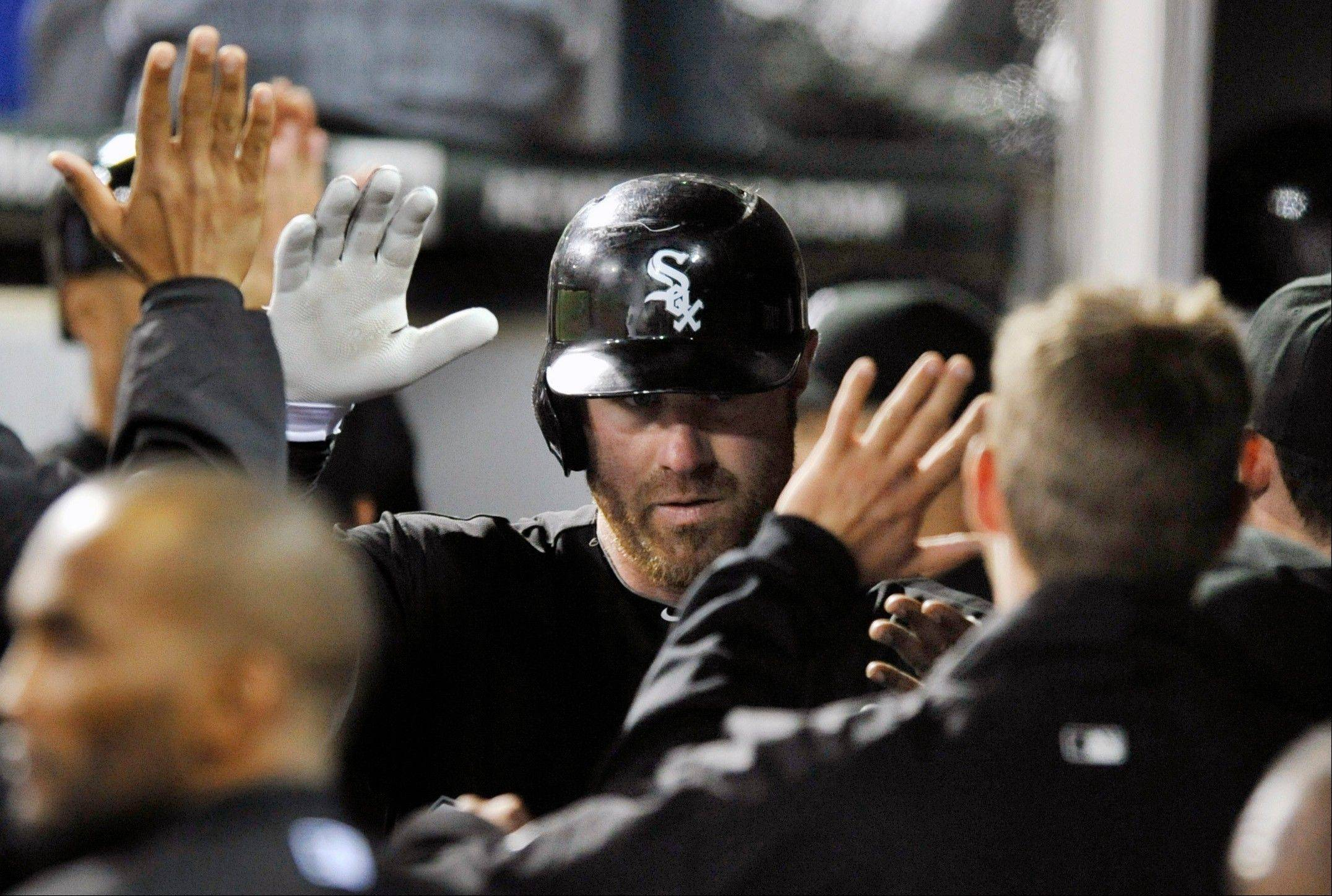 Adam Dunn celebrates with teammates after hitting a 2-run home run against the Tampa Bay Rays during the sixth inning of the White Sox� 5-2 victory Thursday night at U.S. Cellular Field.