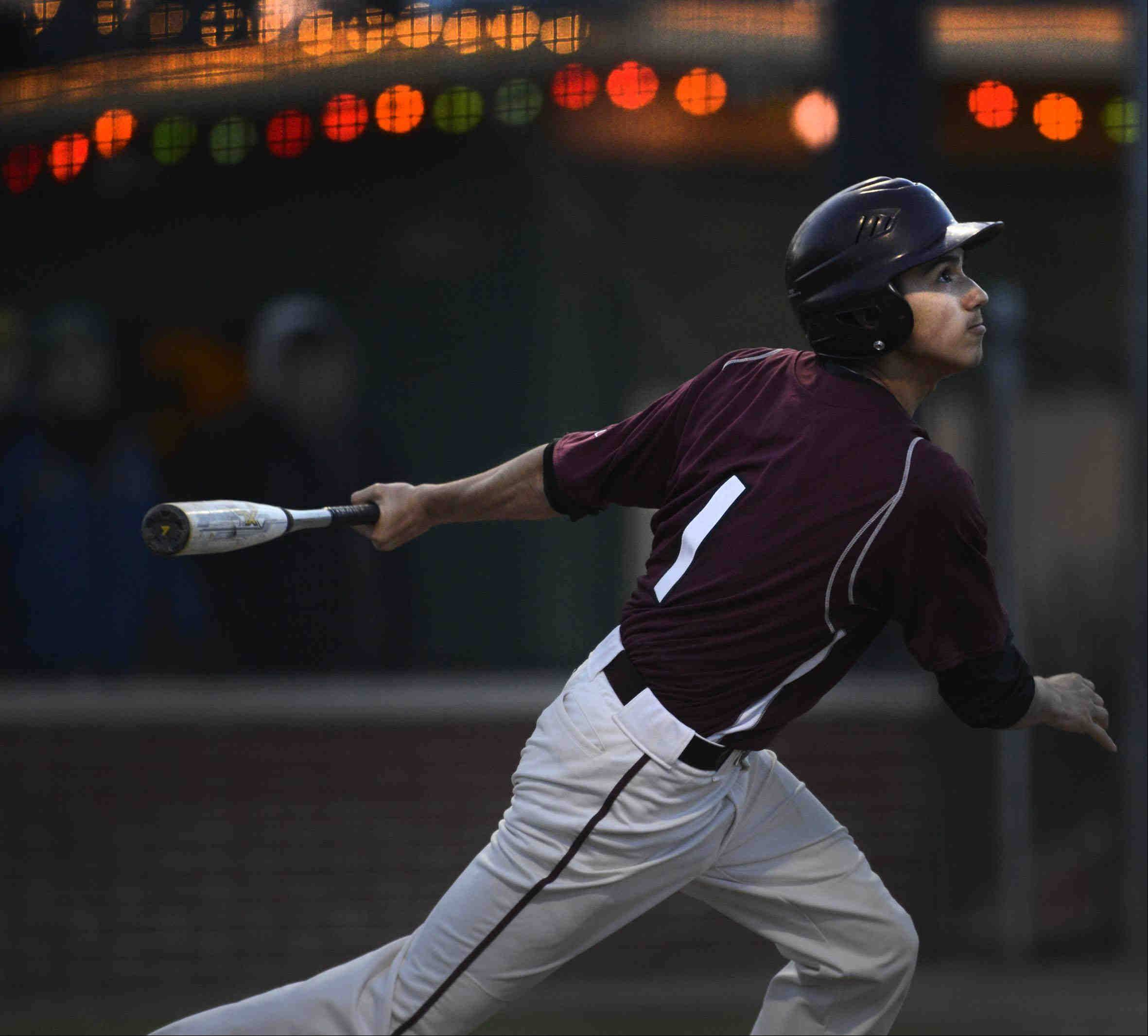 Elgin�s Omar Valadez hits a two-run double in the sixth inning against Larkin Thursday at Trout Park in Elgin.