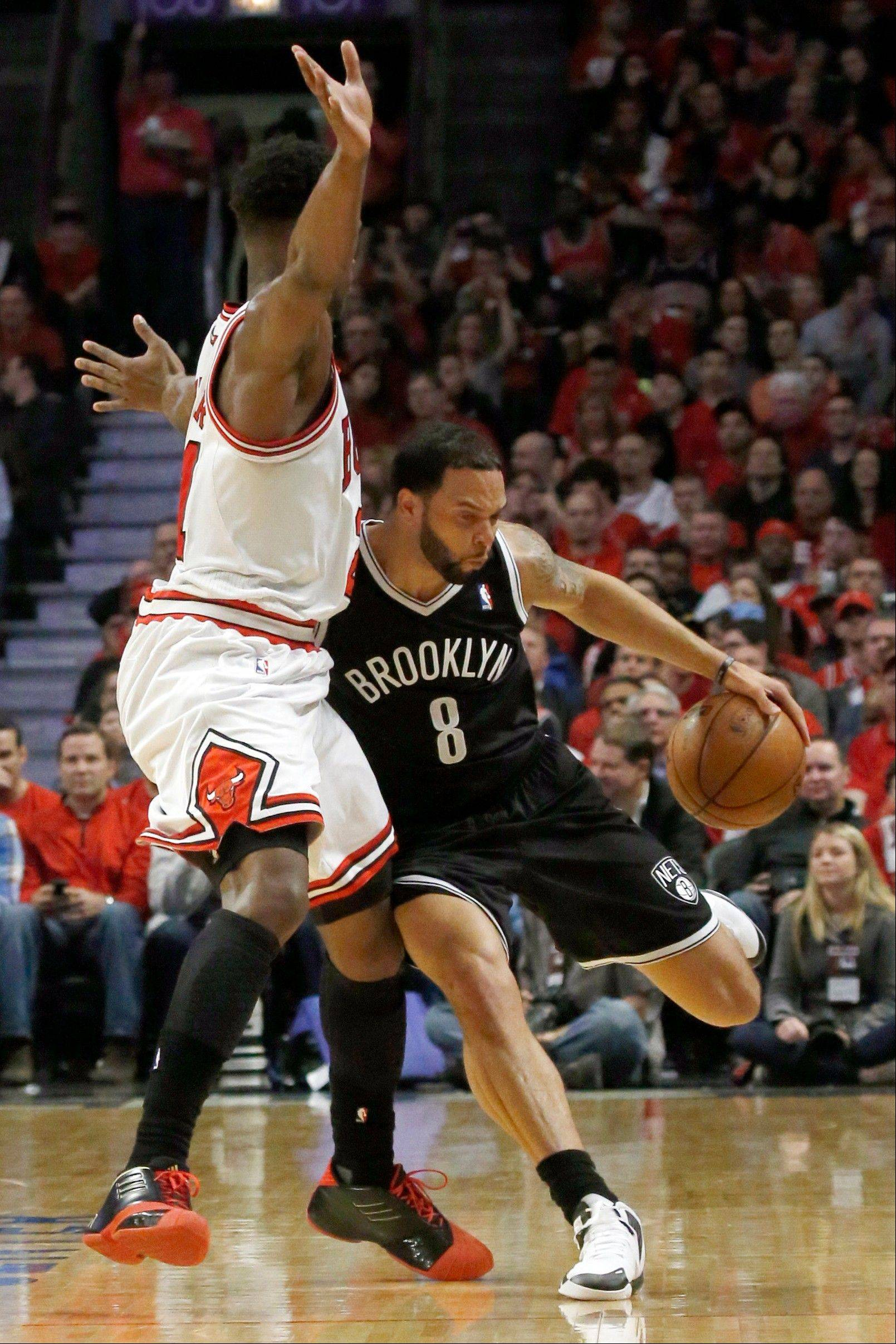 Brooklyn Nets point guard Deron Williams (8) is pressured by Chicago Bulls small forward Jimmy Butler Thursday night at the United Center.