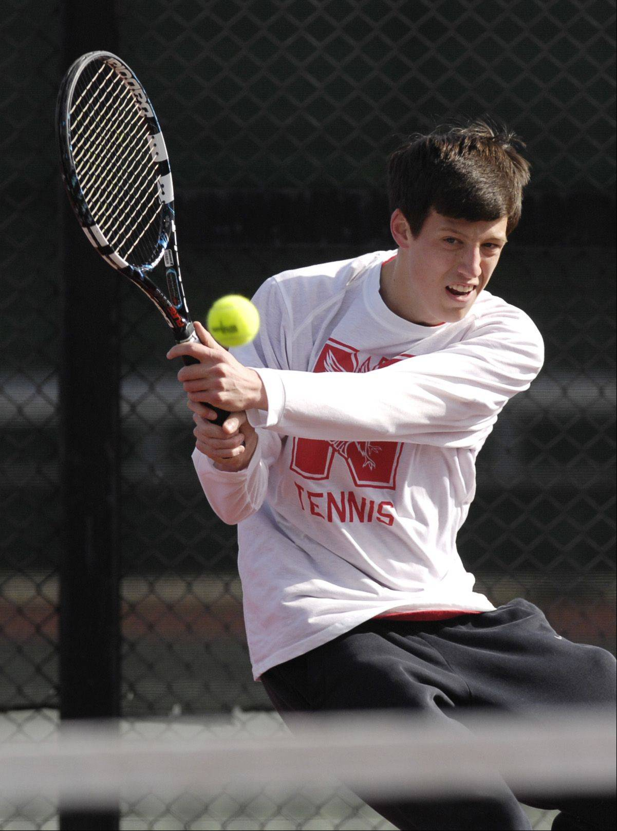 Danny Albert of Naperville Central plays Matt Krzyzaniak of Glenbard North during a varsity tennis match in Carol Stream, Thursday.