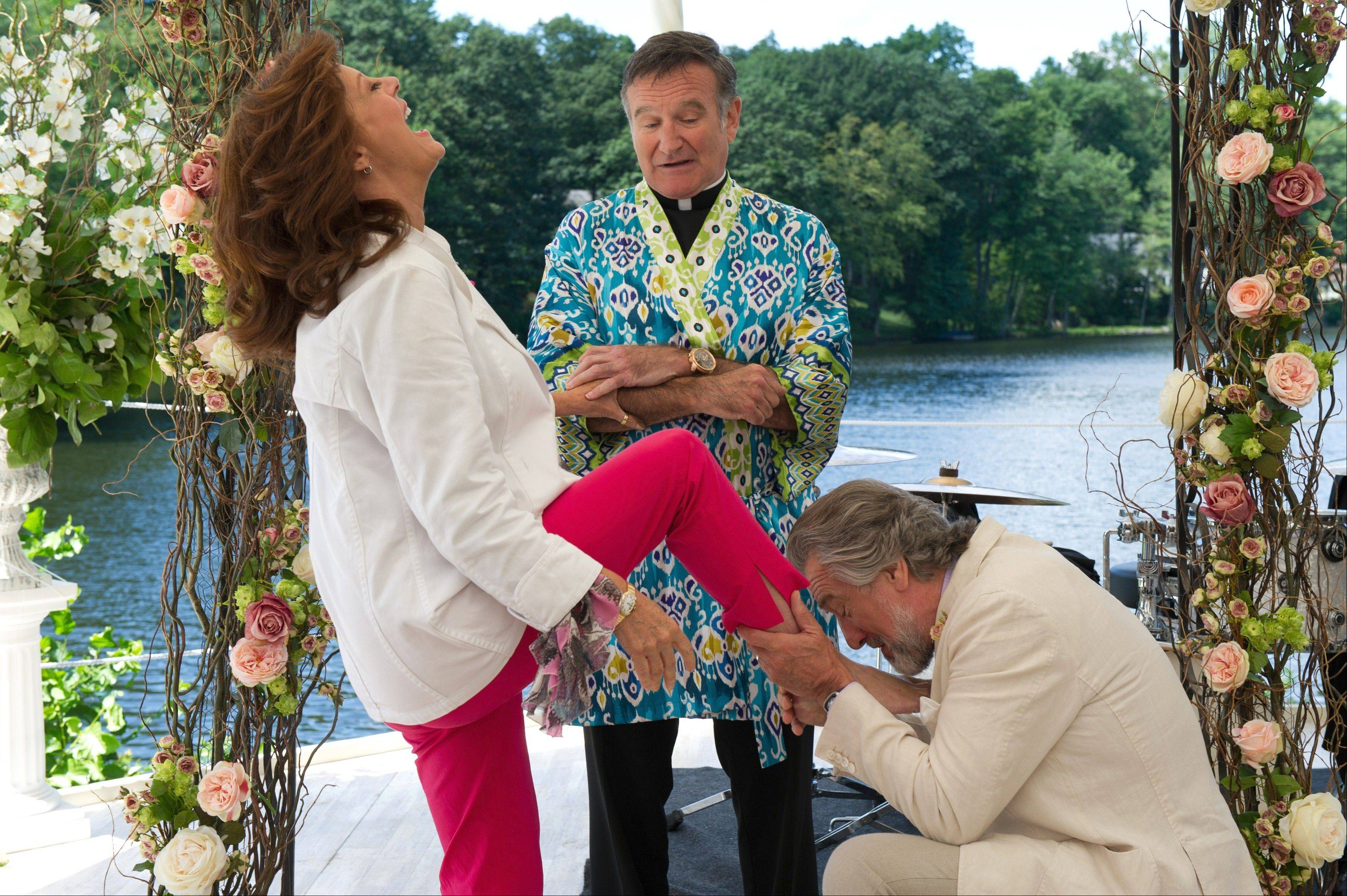 "Bebe (Susan Sarandon) gets a leg up on her live-in lover Don (Robert De Niro) as a priest (Robin Williams) tries to keep a straight face in the funny and poignant ""The Big Wedding."""