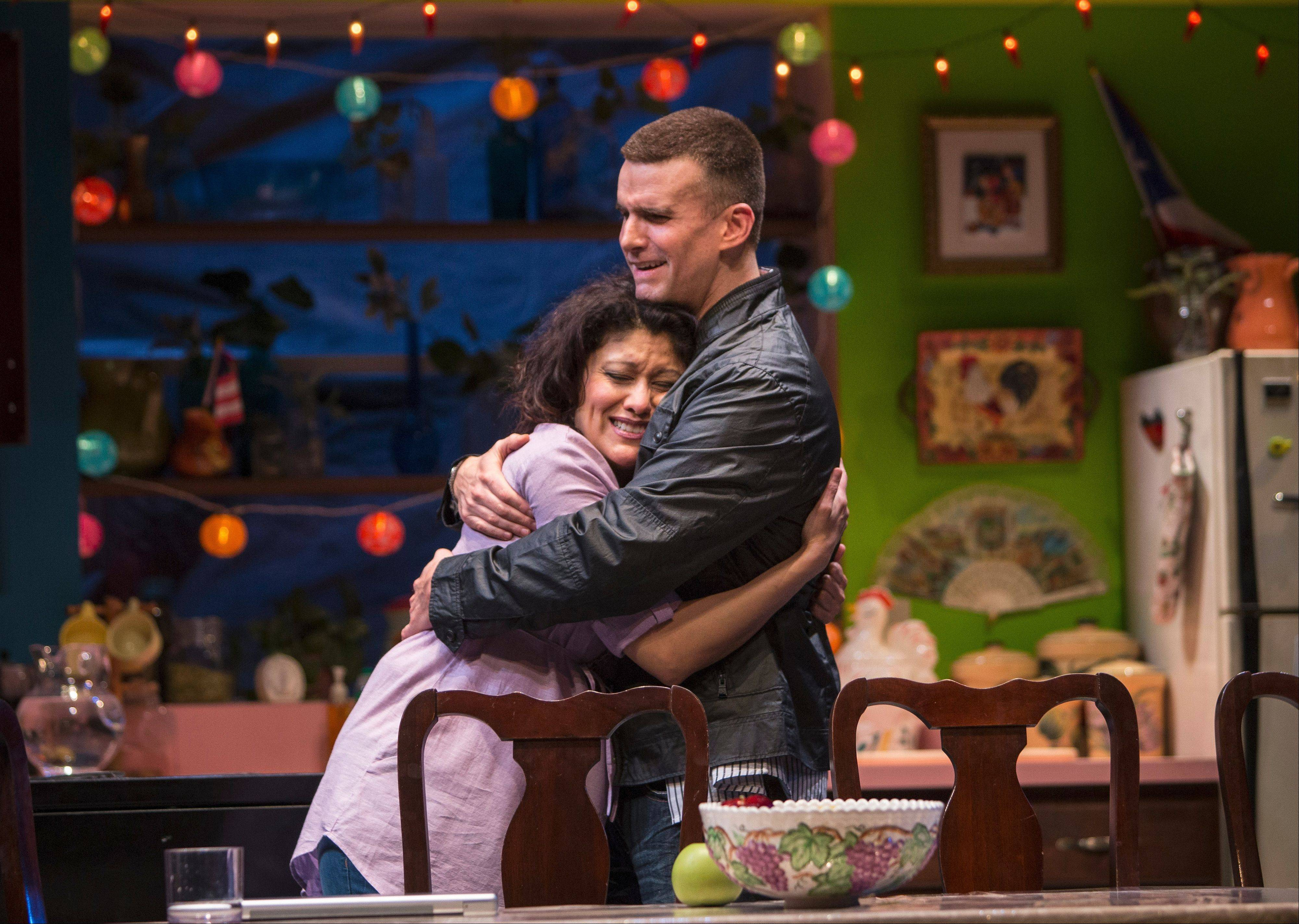 "Yaz (Sandra Marquez) and Elliot (Armando Riesco) embrace in Quiara Alegr�a Hudes' ""The Happiest Song Plays Last"" at Chicago's Goodman Theatre."