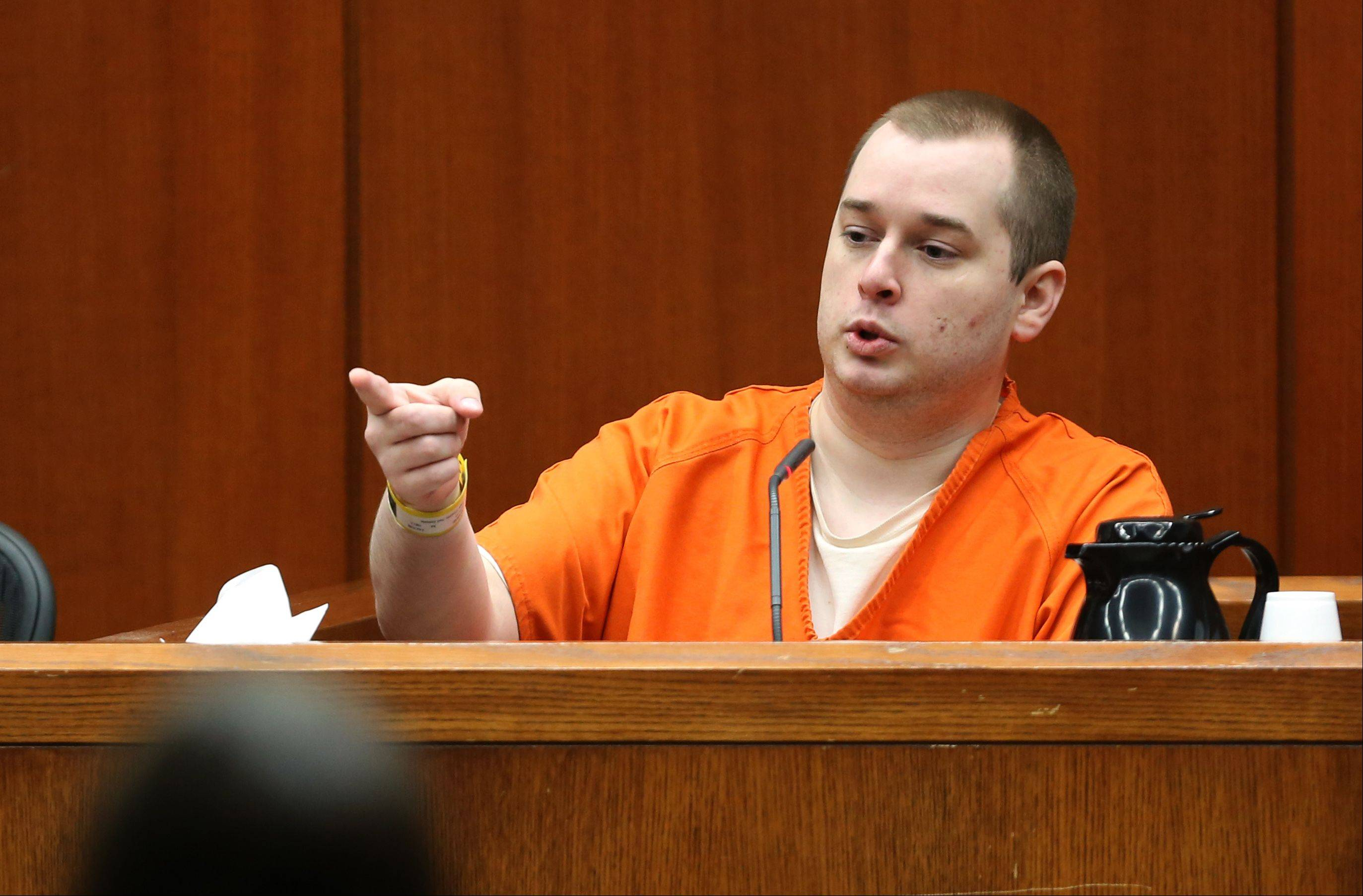Jacob Nodarse points to defendant Johnny Borizov during the Darien triple murder trial Thursday.
