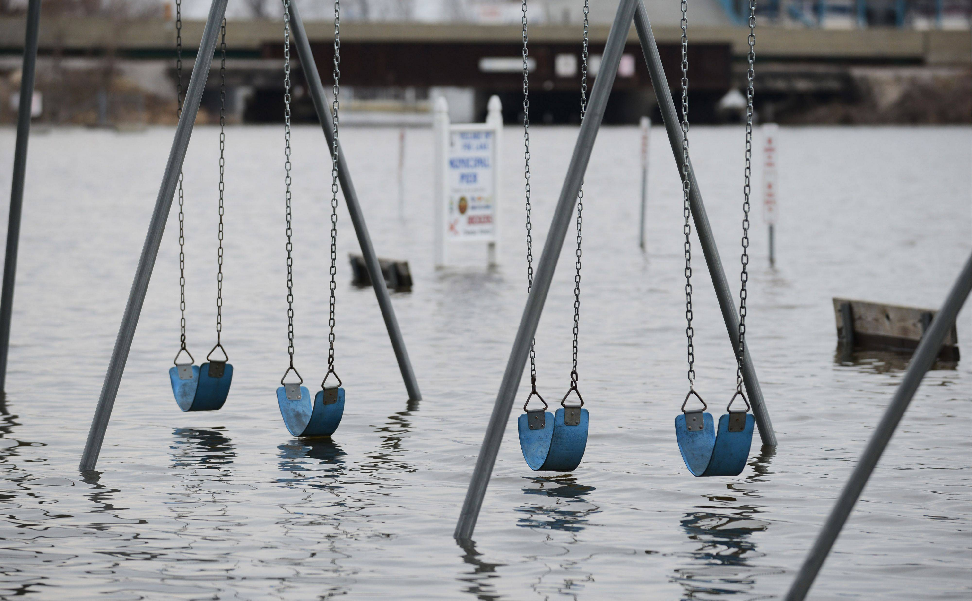 Paul Valade/pvalade@dailyherald.com Swing sets are under water at Lakefront Park in Fox Lake Tuesday.