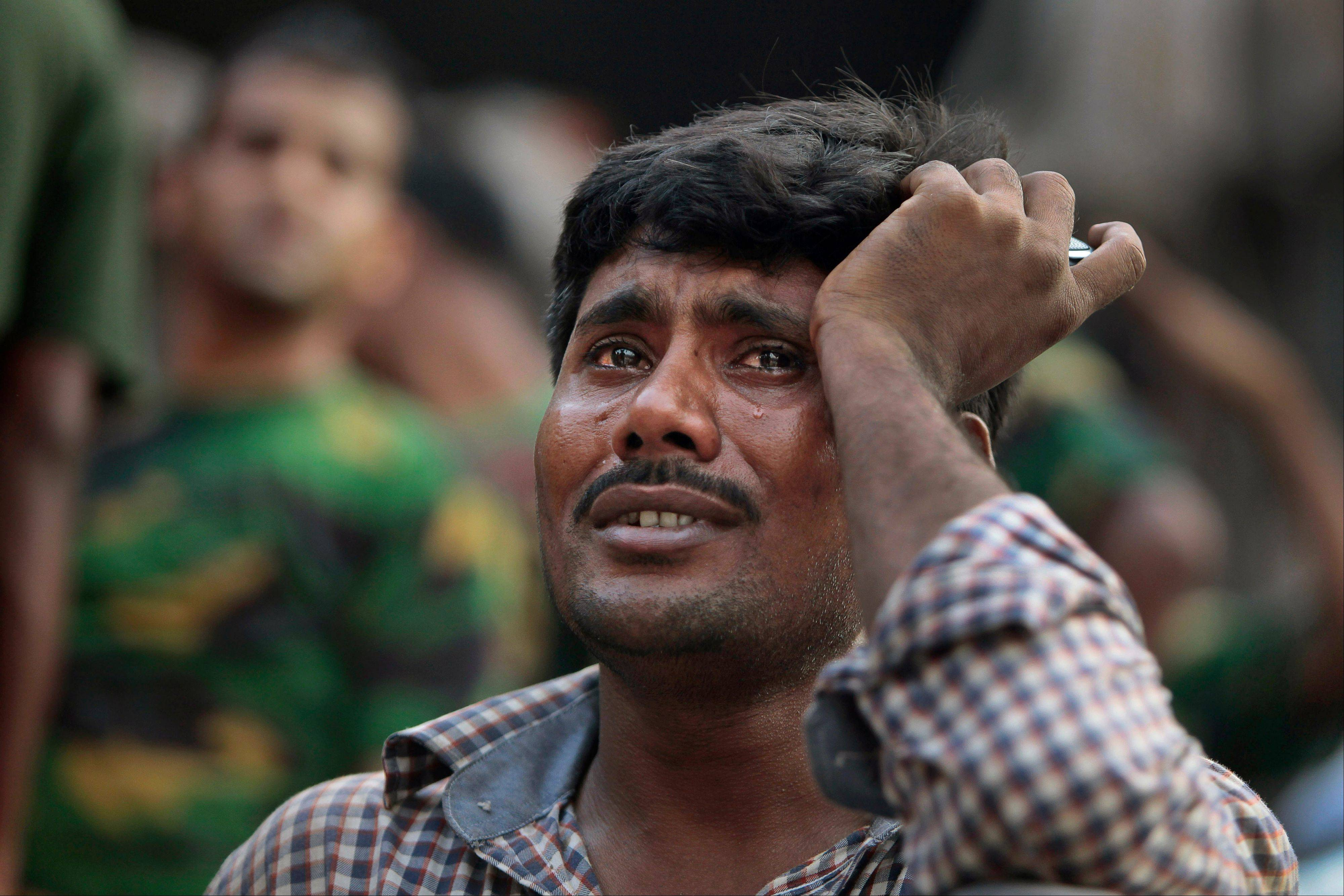 A Bangladeshi relative of a victim cries at the site of a building that collapsed Wednesday in Savar, near Dhaka, Bangladesh, Thursday, April 25, 2013. By Thursday, the death toll had reached more than 230.