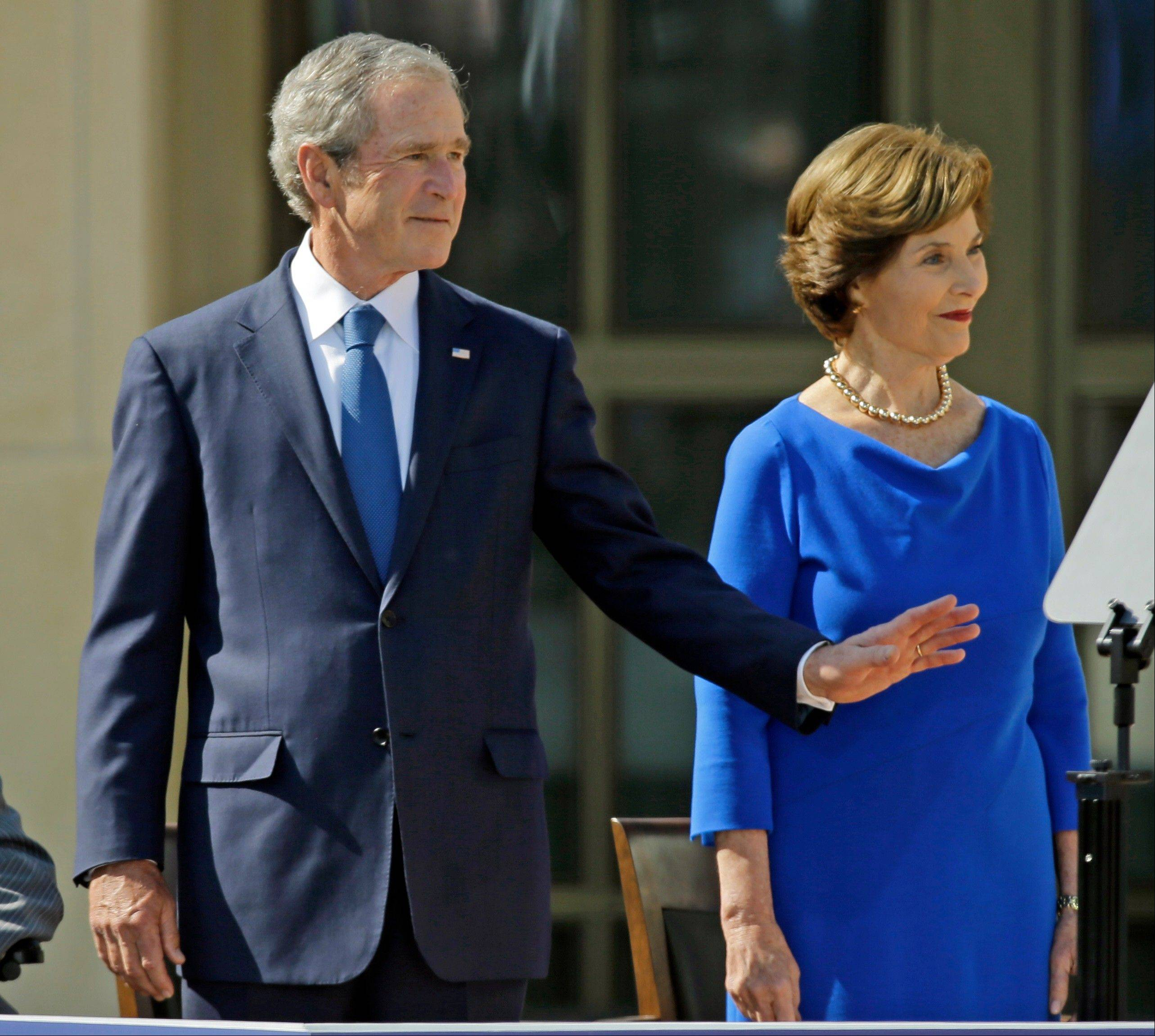 Former President George W. Bush and his wife, former first lady Laura Bush, arrive the dedication of the George W. Bush Presidential Center, Thursday, April 25, 2013, in Dallas.
