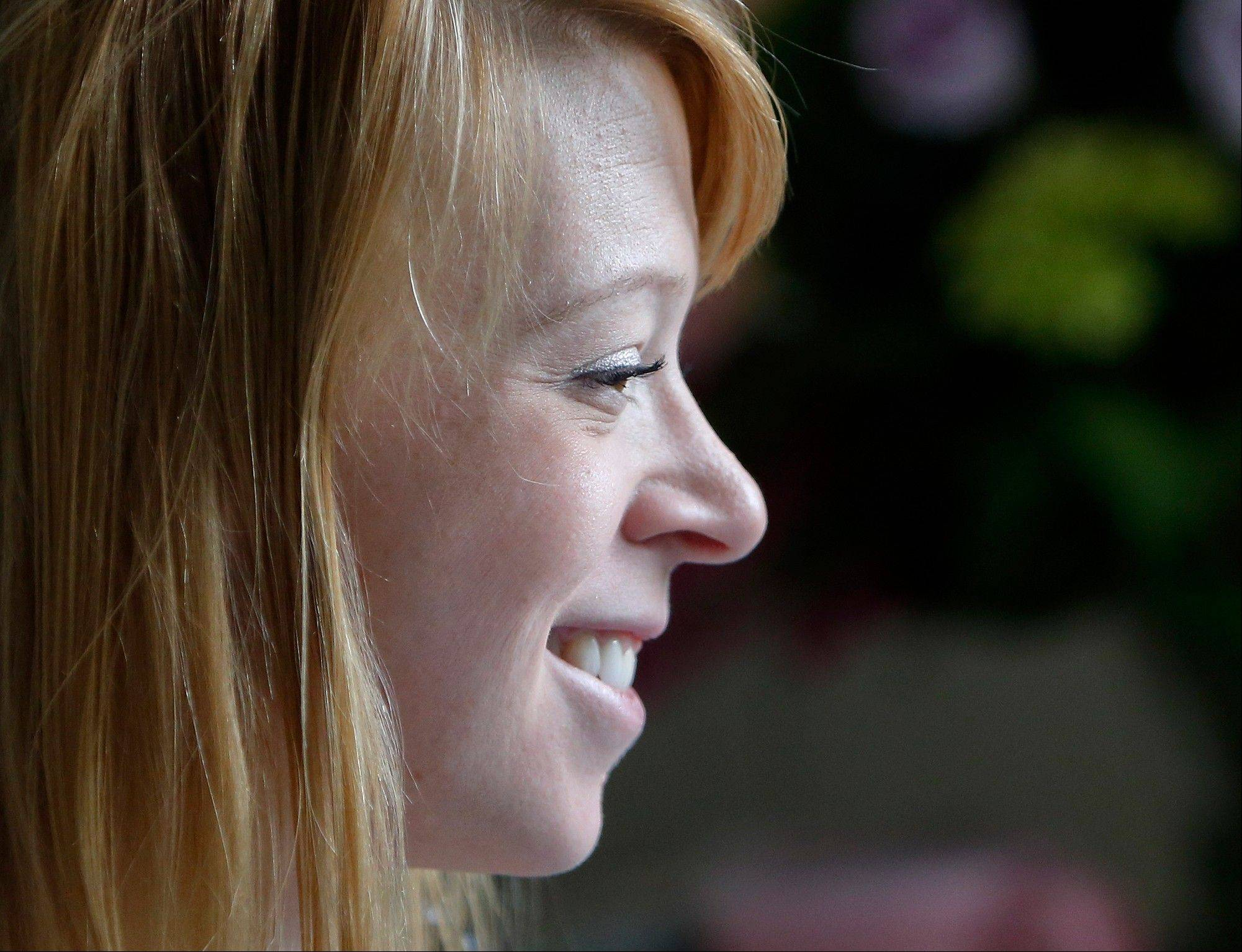 Adrianne Haslet, a professional ballroom dancer injured by one of the bombs that exploded near the Boston Marathon finish line, smiles in her room at Spaulding Rehabilitation Hospital in Boston, Wednesday, April 24, 2013. Haslet, who lost her left foot and part of her lower leg, vows that she will dance again.
