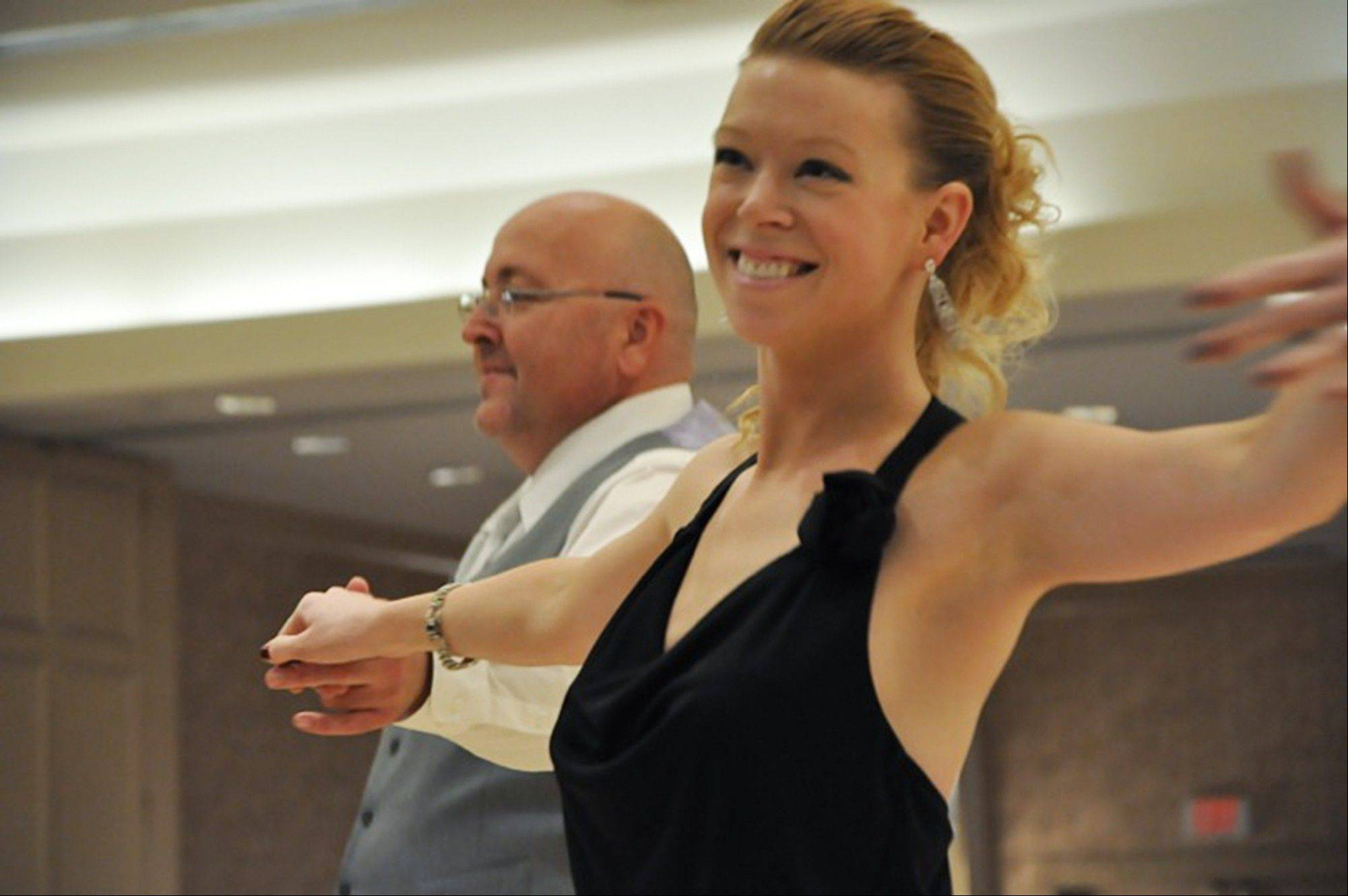 This 2012 photo provided by the Arthur Murray Boston Studio shows Adrianne Haslet during a dance competition in the Boston area. Haslet, a professional ballroom dancer injured by one of the bombs that exploded near the Boston Marathon finish line, on Monday, April 15, 2013, vows she will dance again.
