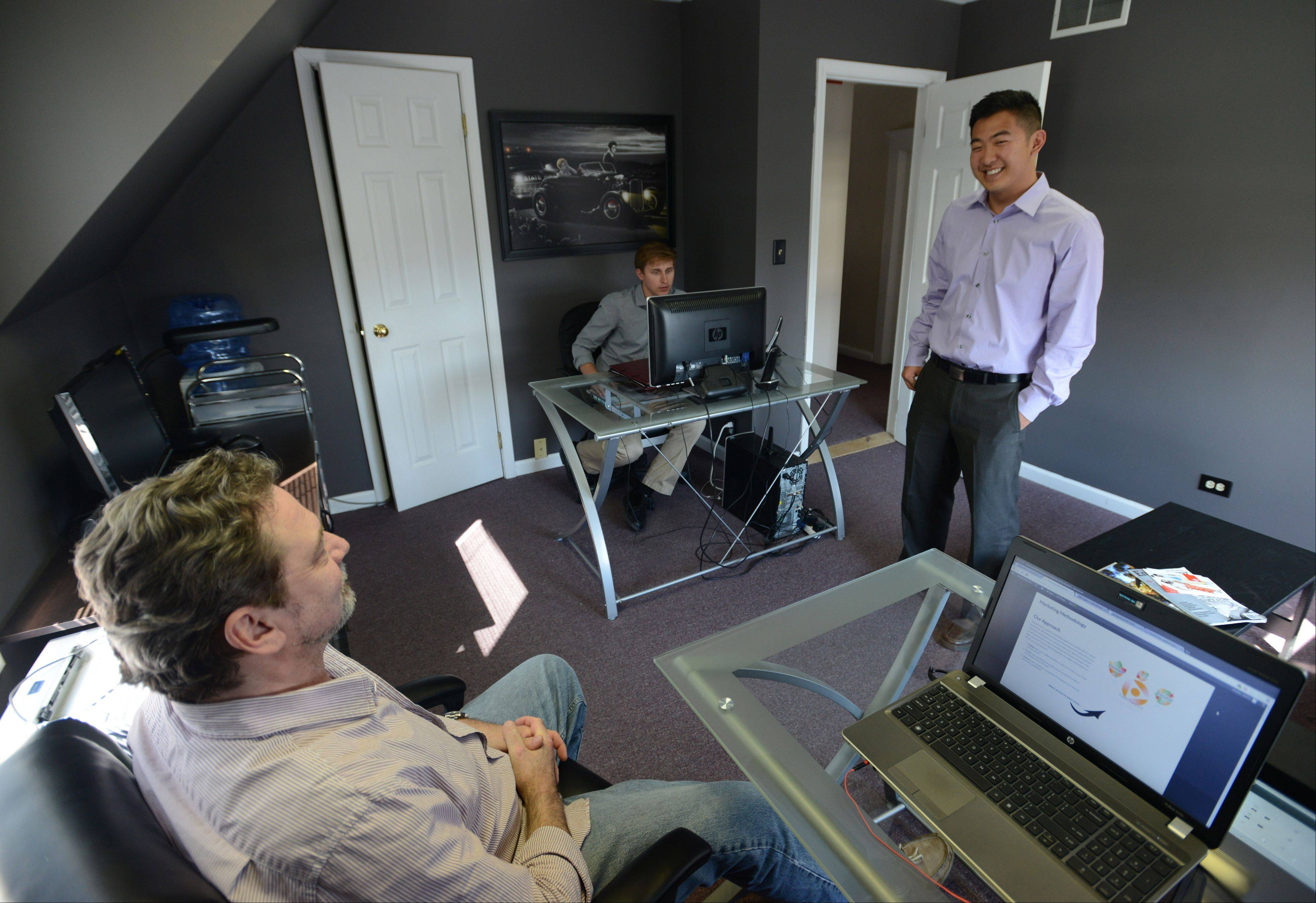 Wilbur You, 22, talks with Youtech technology director Frank Hilgers.