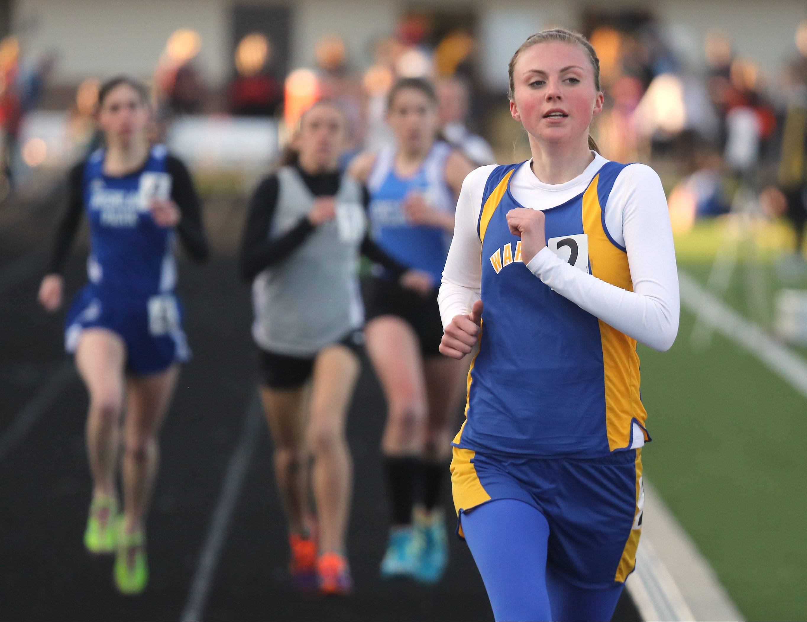 Warren runner Meg Tully leads the 3,200 for much of the race before ending up second during the Lake County meet Thursday at Grayslake North.