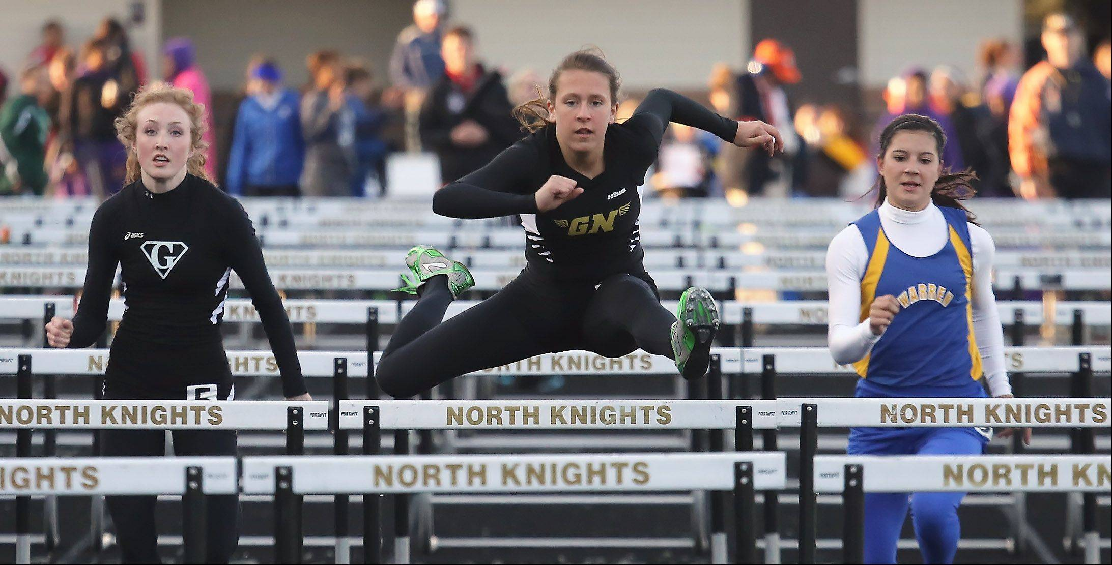 Grayslake North hurdler Allie O'Connell leads the pack as she wins the 100 hurdles during the Lake County meet Thursday at Grayslake North.