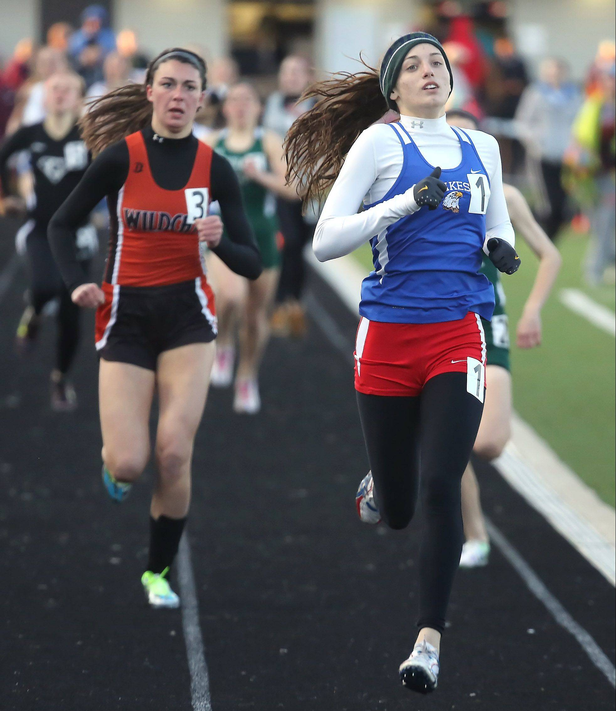 Lakes runner Danielle Griesbaum, right, finishes first with Libertyville's Carly Stewart coming in second in the 800 run during the Lake County meet Thursday at Grayslake North.