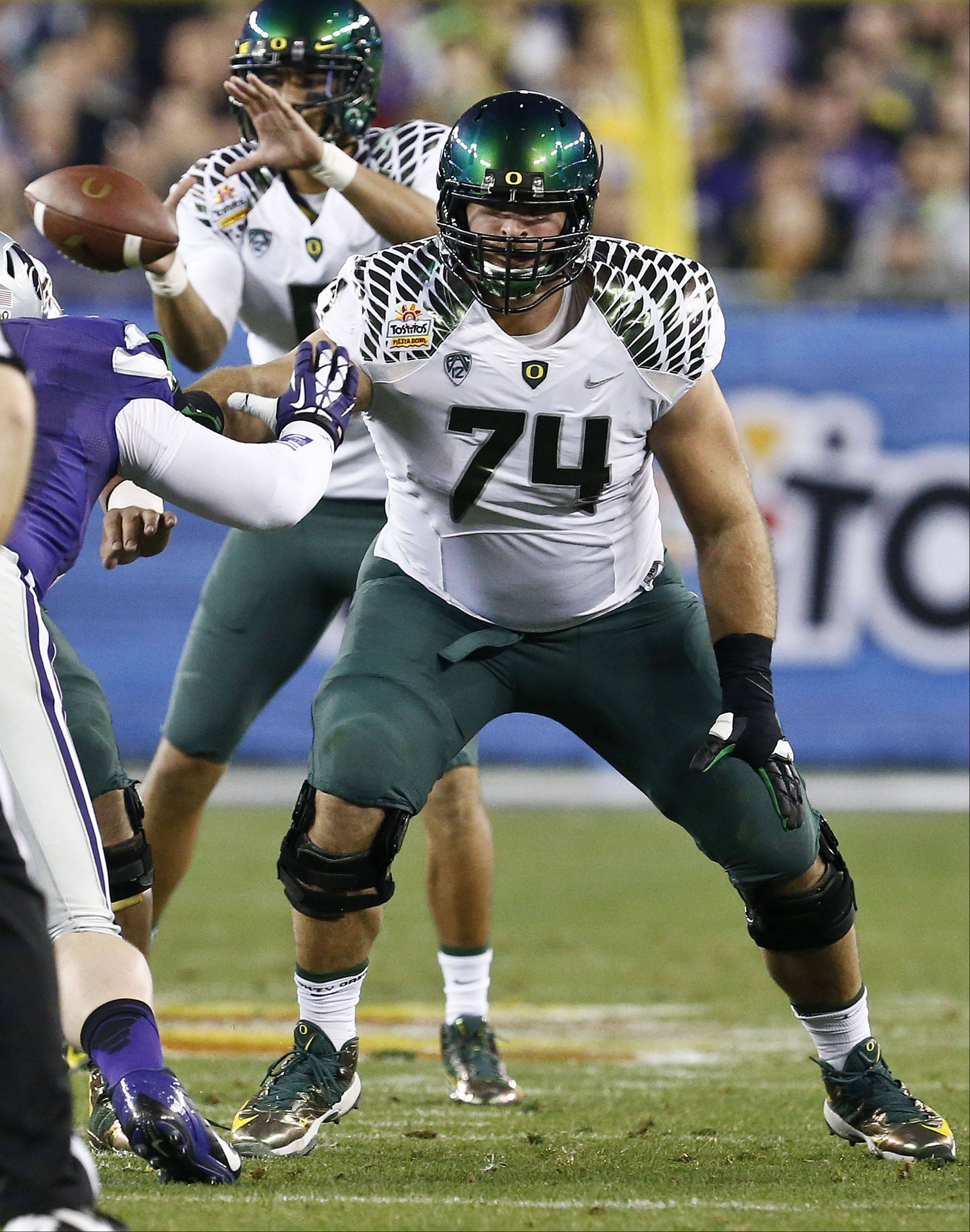 Oregon's Kyle Long (74) blocks Kansas State defender during the Fiesta Bowl NCAA college football game Thursday, Jan. 3, 2013, in Glendale, Ariz. Oregon defeated Kansas State 35-17.