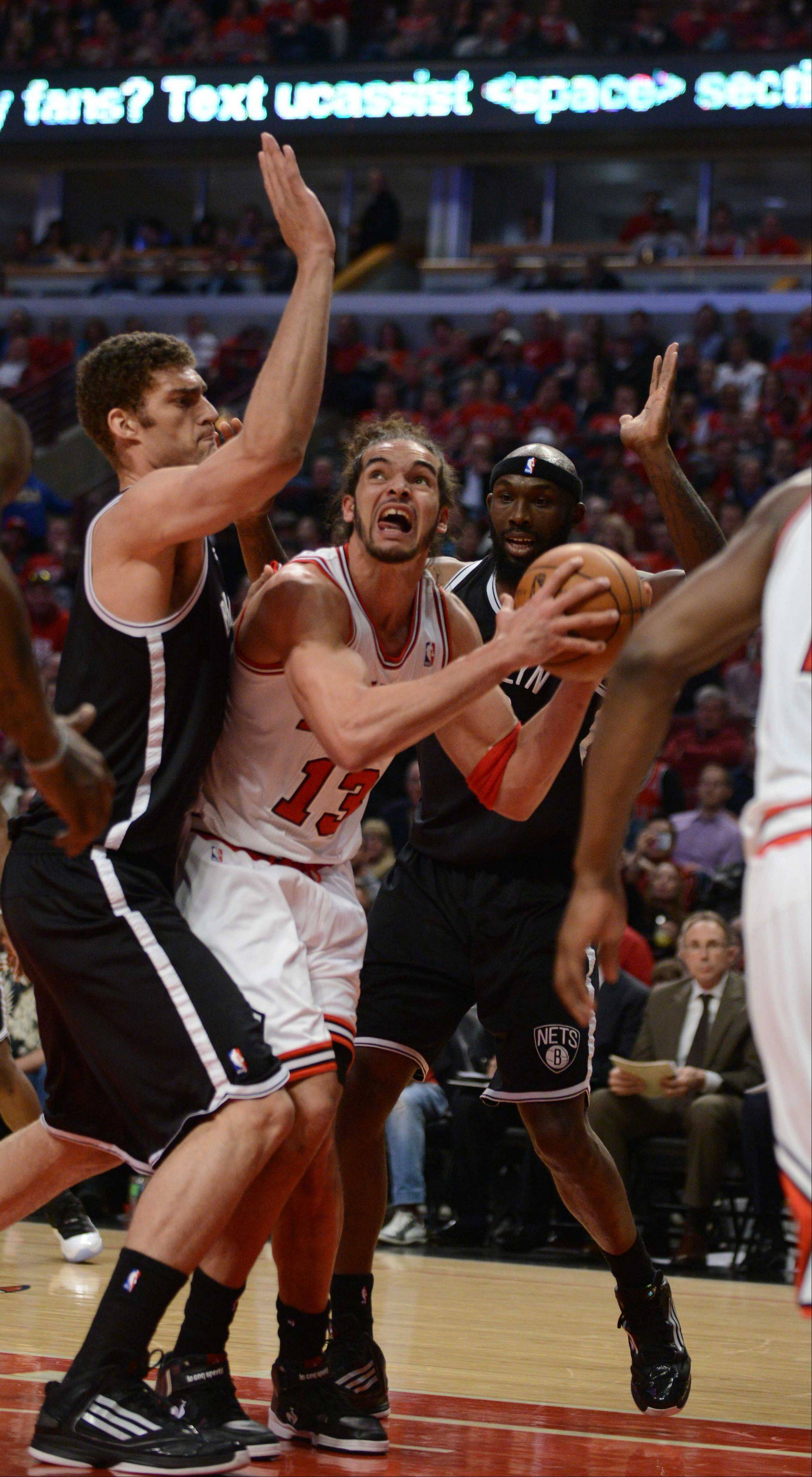 Joakim Noah of Chicago looks for a shot.