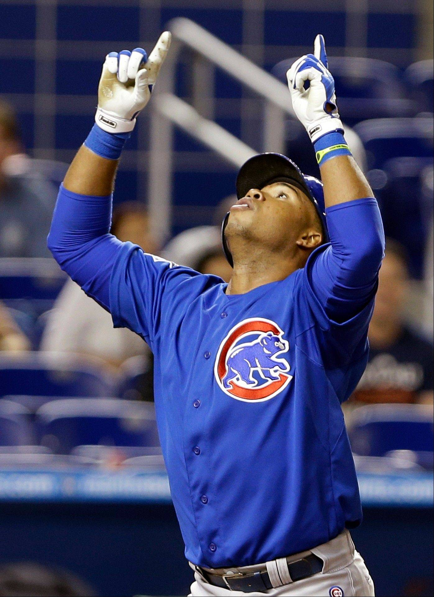 Cubs third baseman Luis Valbuena celebrates as he crosses home plate after hitting the tiebreaking solo home run during the ninth inning Thursday night. The Cubs defeated the Marlins 4-3.