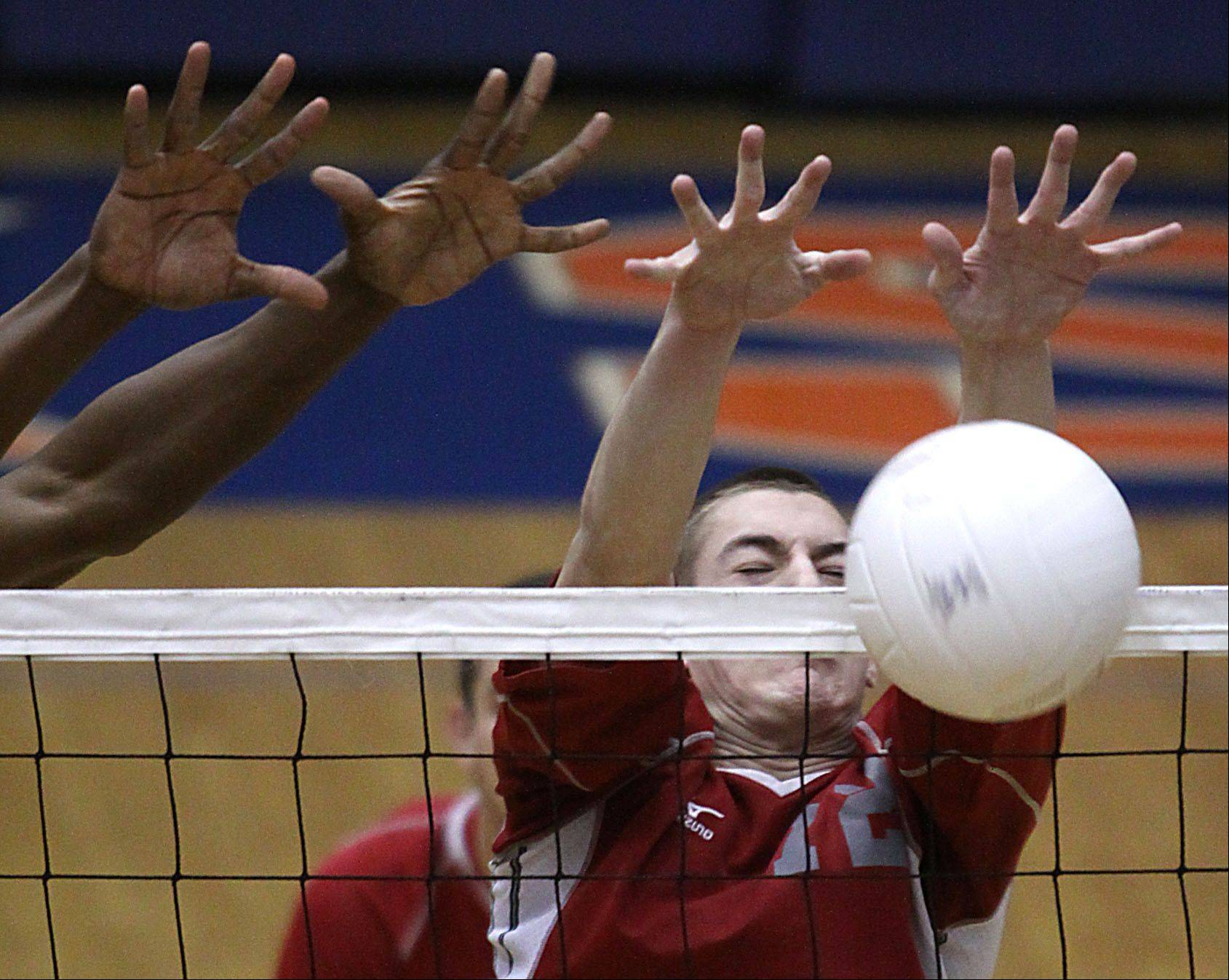 Palatine's Danny Matijevic blocks an attack during Thursday's match at Hoffman Estates.