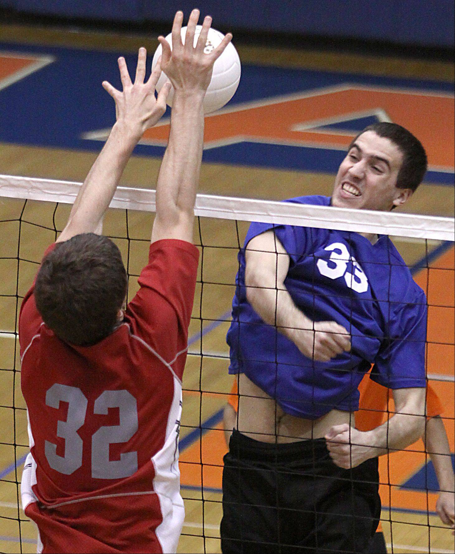 Hoffman Estates' Connor Rodheim, right, tries to pound the ball past Palatine's Jerry Sommerfeld at Hoffman Estates on Thursday.