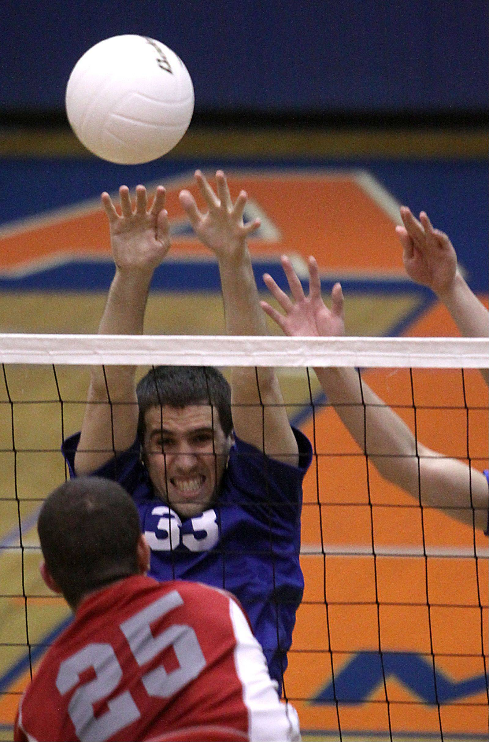 Hoffman Estates' Connor Rodheim, top, blocks the shot of Palatine's Brian Keough at Hoffman Estates on Thursday.