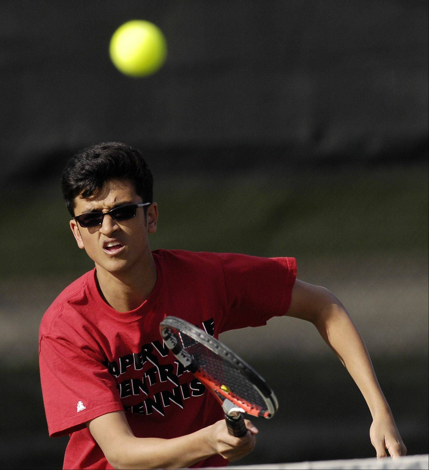 Sid Swamy of Naperville Central plays Matt Mistro of Glenbard North during a varsity tennis match in Carol Stream, Thursday.