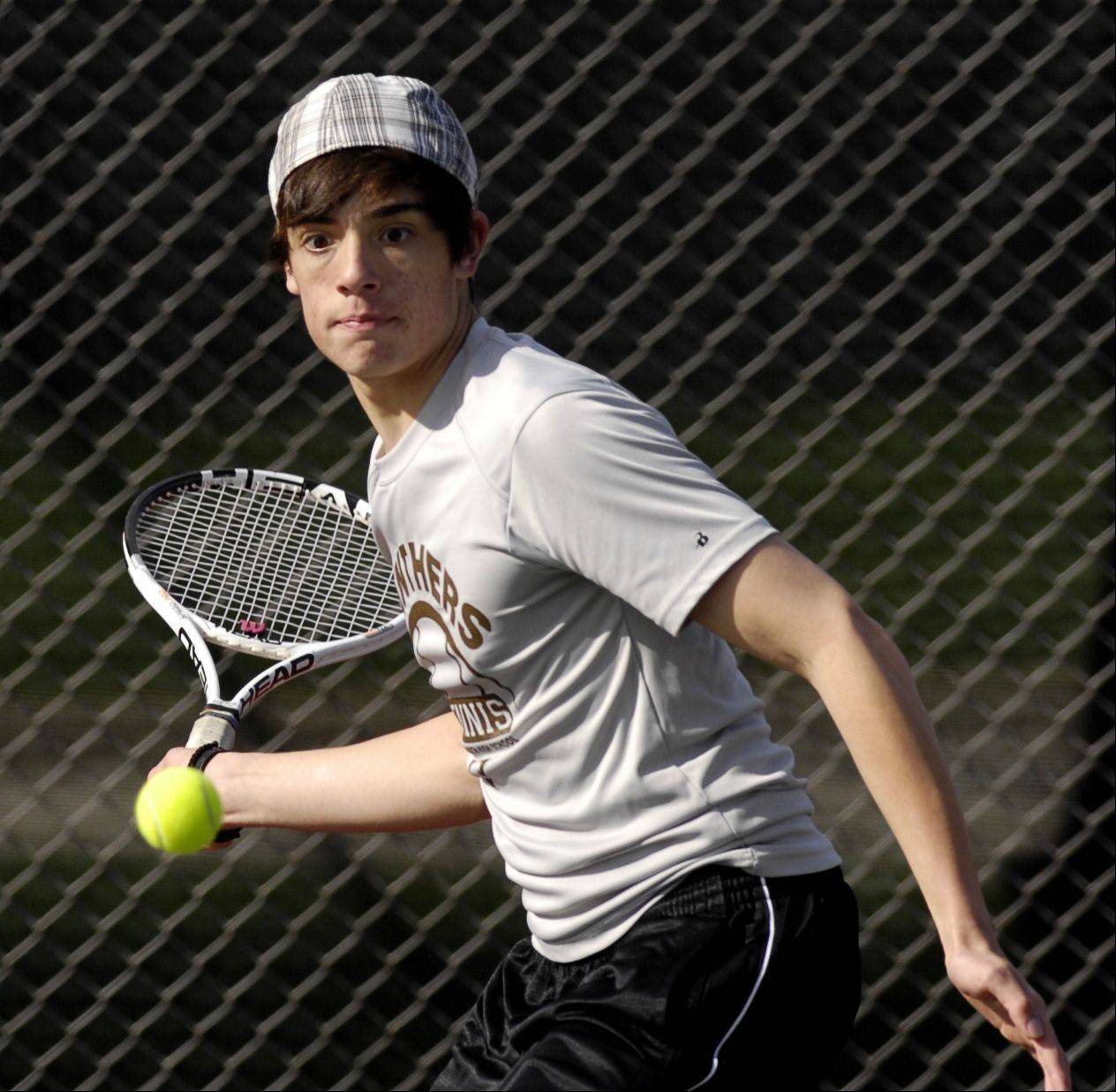Matt Krzyzaniak of Glenbard North plays Danny Albert of Naperville Central during a varsity tennis match in Carol Stream, Thursday.
