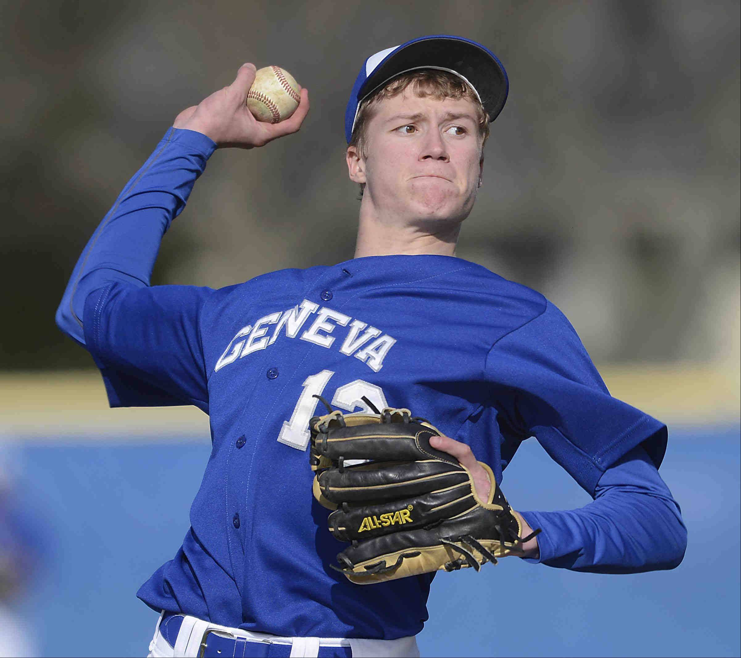 Geneva starting pitcher Brock Chenier throws against St. Charles East Thursday in Geneva.