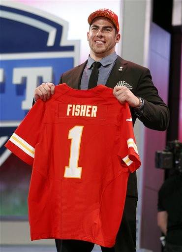 NFL teams bought in bulk early in Thursday night's draft. Unlike the last few glam-and-glitter years when bumper crops of quarterbacks reigned, this was pure brawn: more than 600 pounds at the outset with offensive tackles Eric Fisher of Central Michigan and Luke Joeckel of Texas A&M. The first seven picks were all linemen: four on offense, three on defense.