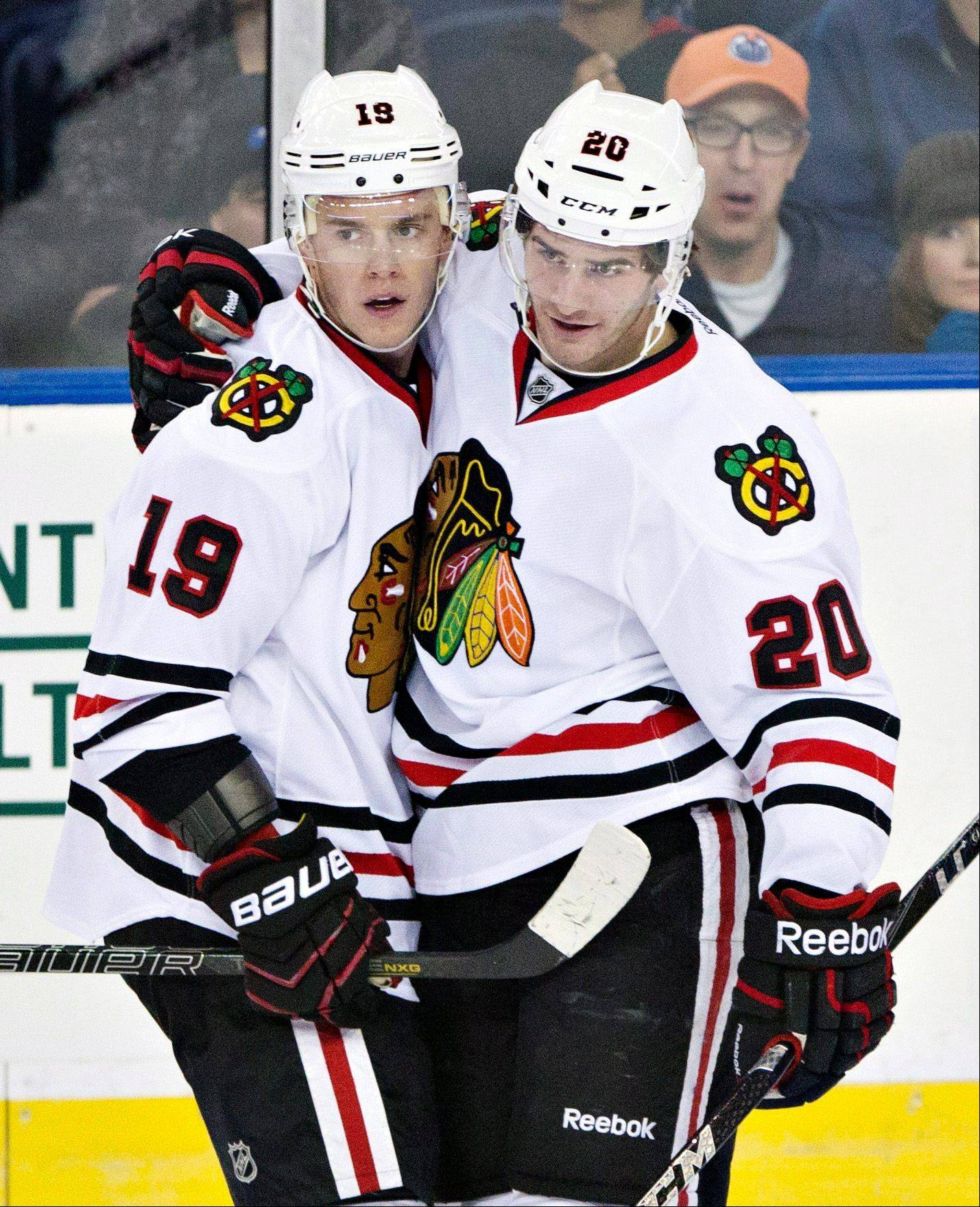 Chicago Blackhawks' Jonathan Toews (19) and Brandon Saad celebrate a goal on the Edmonton Oilers during the first period of their NHL hockey game in Edmonton, Alberta, Wednesday, April 24, 2013.