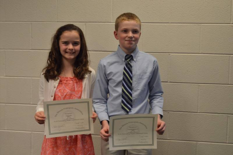 Rockland fifth-graders Taylor Petz, left, and Matthew Krukonis were honored recently by the Lake Region Illinois Principals Association for always being students of high character.