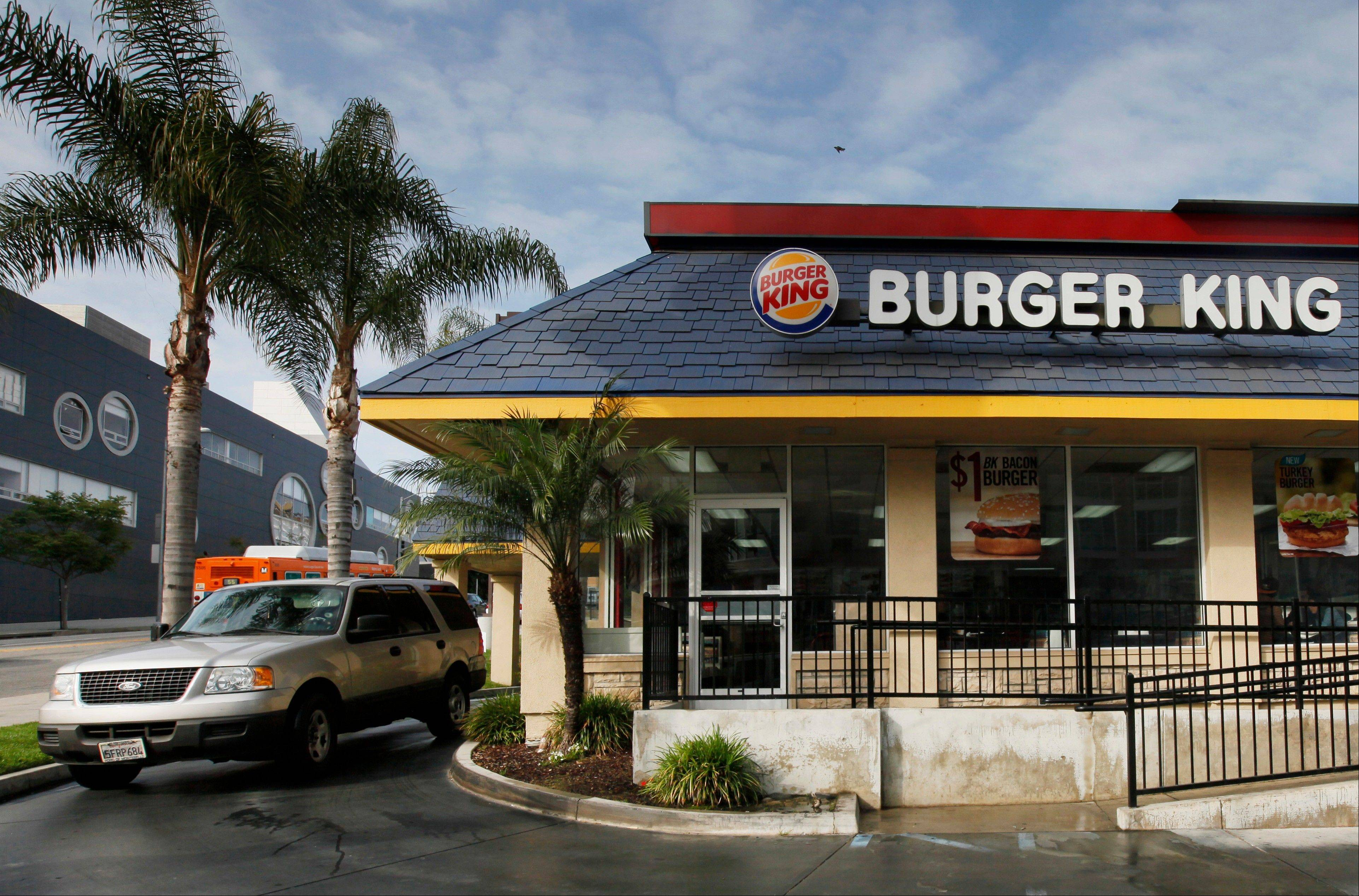Burger King�s first-quarter earnings more than doubled even though revenue fell, as the fast-food chain trimmed several restaurant-related expenses.