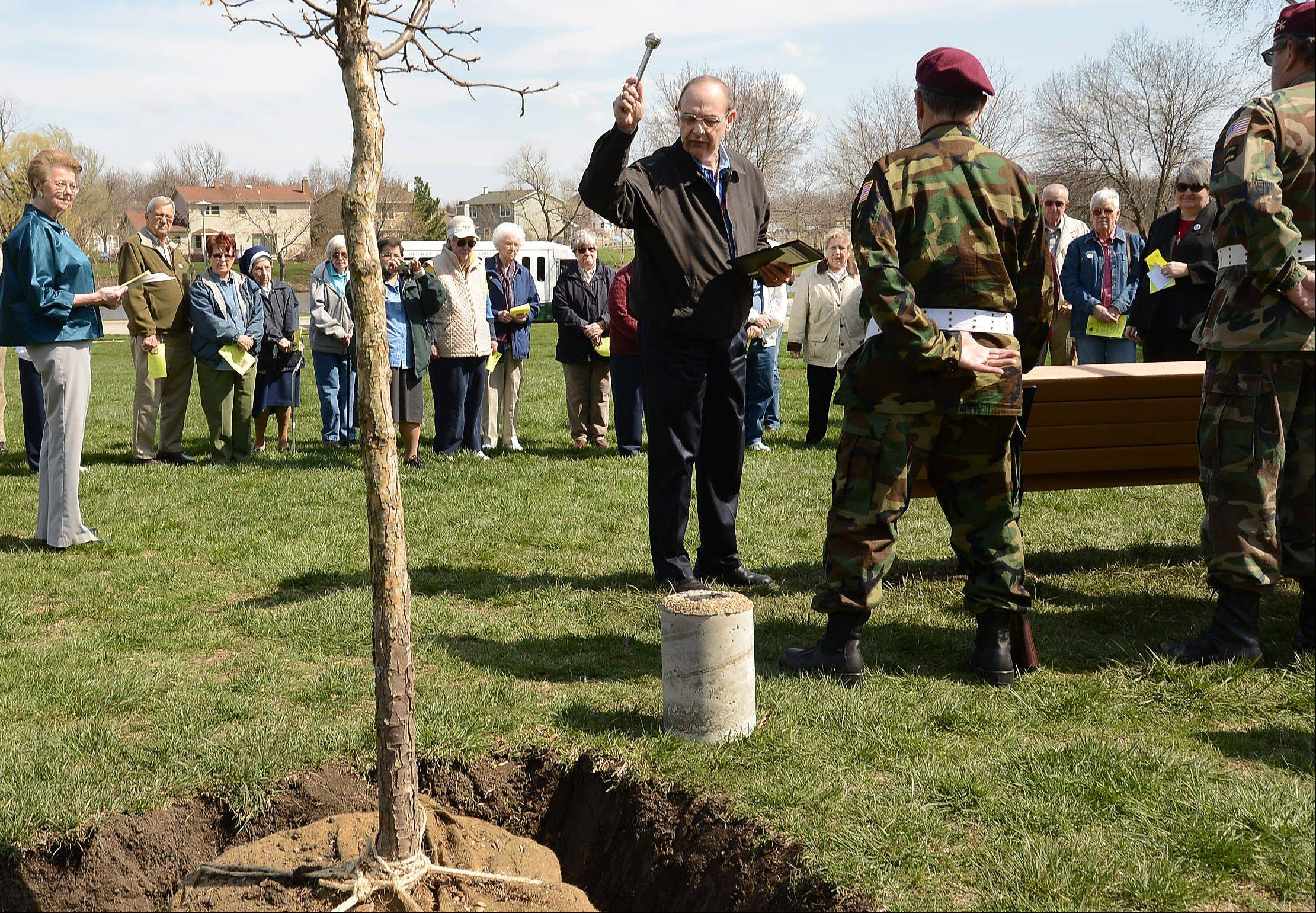 Deacon Larry Migliorato, chaplain of Clare Oaks, blesses the trees newly planted in Oak Grove Park.