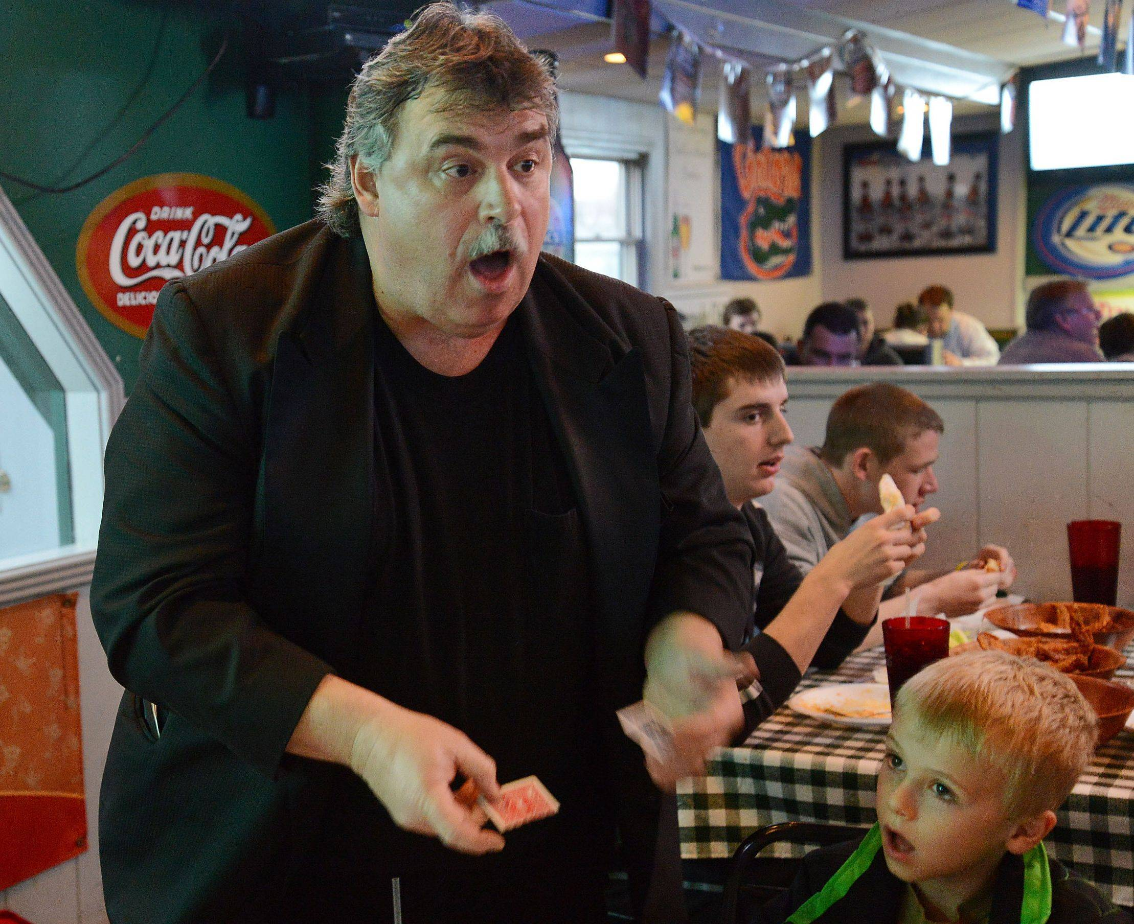 Magician Mark Doetsch especially likes performing magic for the kids at Gators in Palatine.
