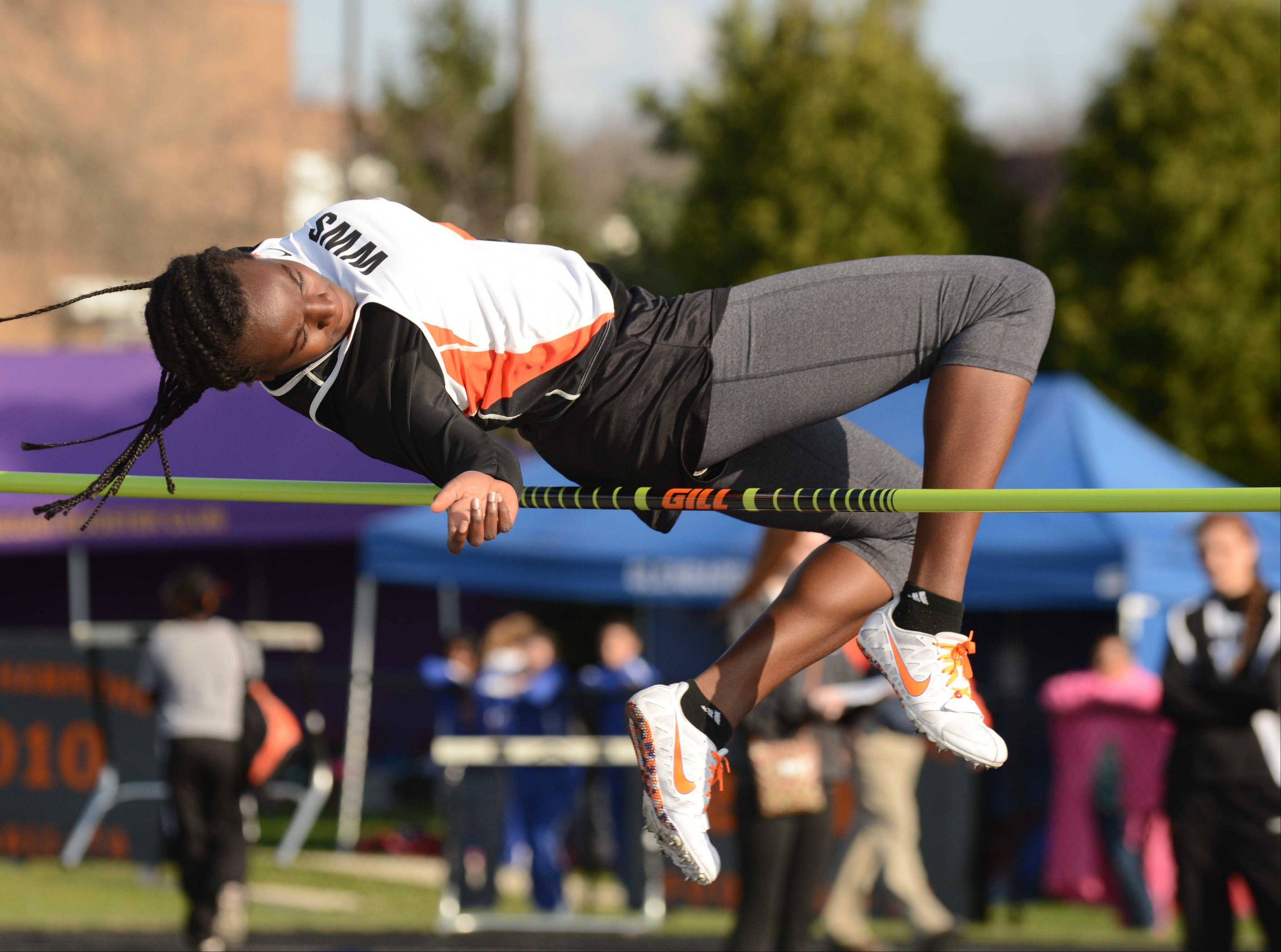 Teso Coker of Wheaton Warrenville south just clears the bar at 5.1 during the Wheaton Warrenville South girls track meet Friday.