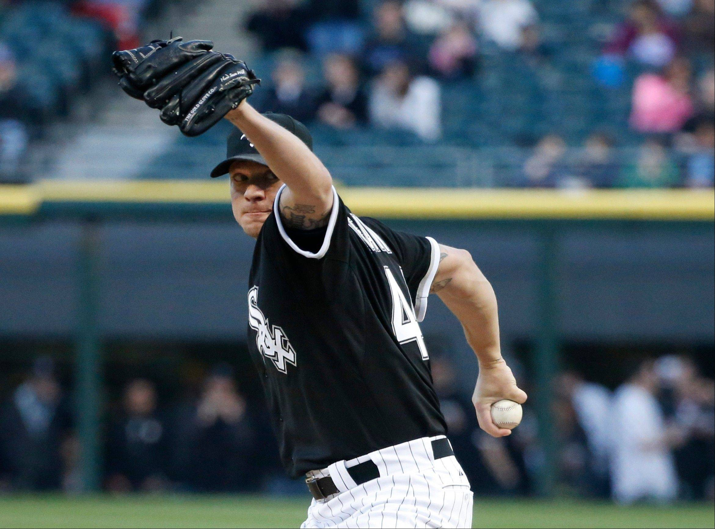 Chicago White Sox starting pitcher Jake Peavy delivers during the first inning of a baseball game against the Tampa Bay Rays Friday, April 26, 2013, in Chicago. (AP Photo/Charlie Arbogast)