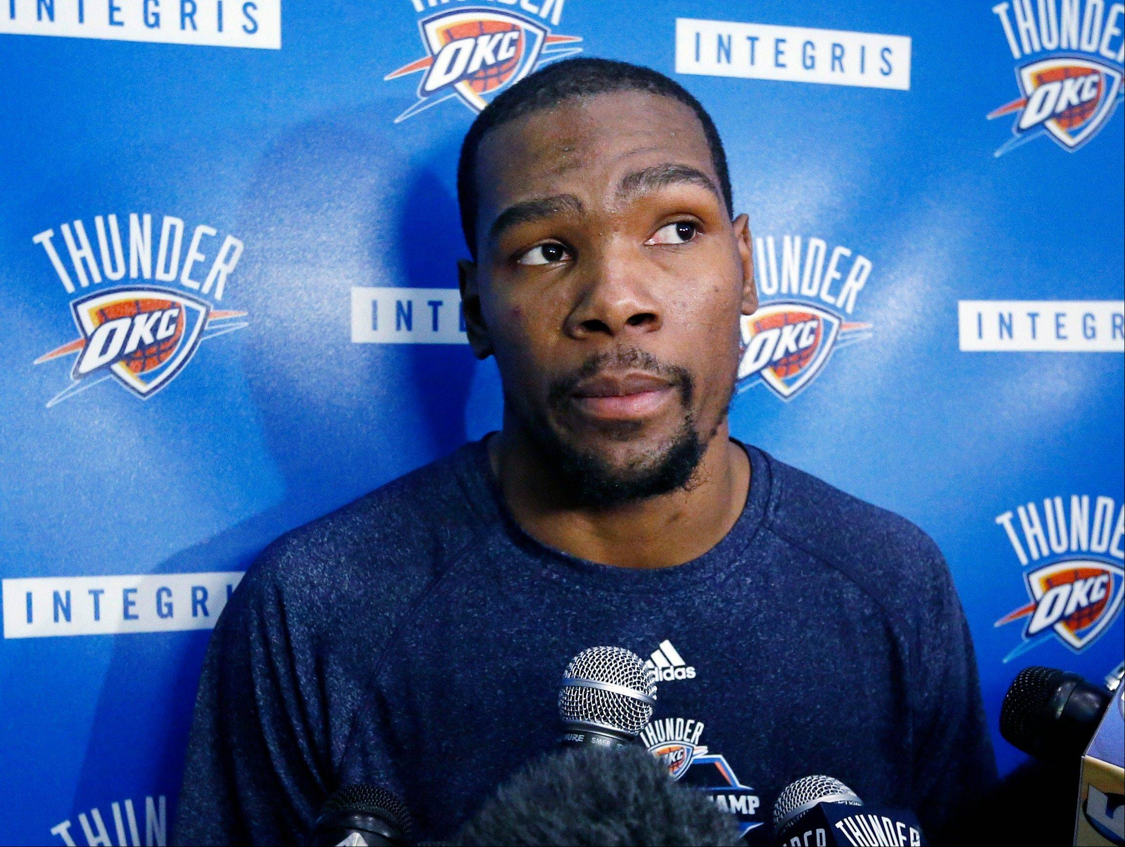 Oklahoma City Thunder forward Kevin Durant answers a question during a news conference at NBA basketball practice in Oklahoma City, Friday, April 26, 2013. All-Star point guard Russell Westbrook will have surgery to repair cartilage in his right knee and be out indefinitely, dealing a harsh blow to the Thunder's championship chances. (AP Photo/Sue Ogrocki)