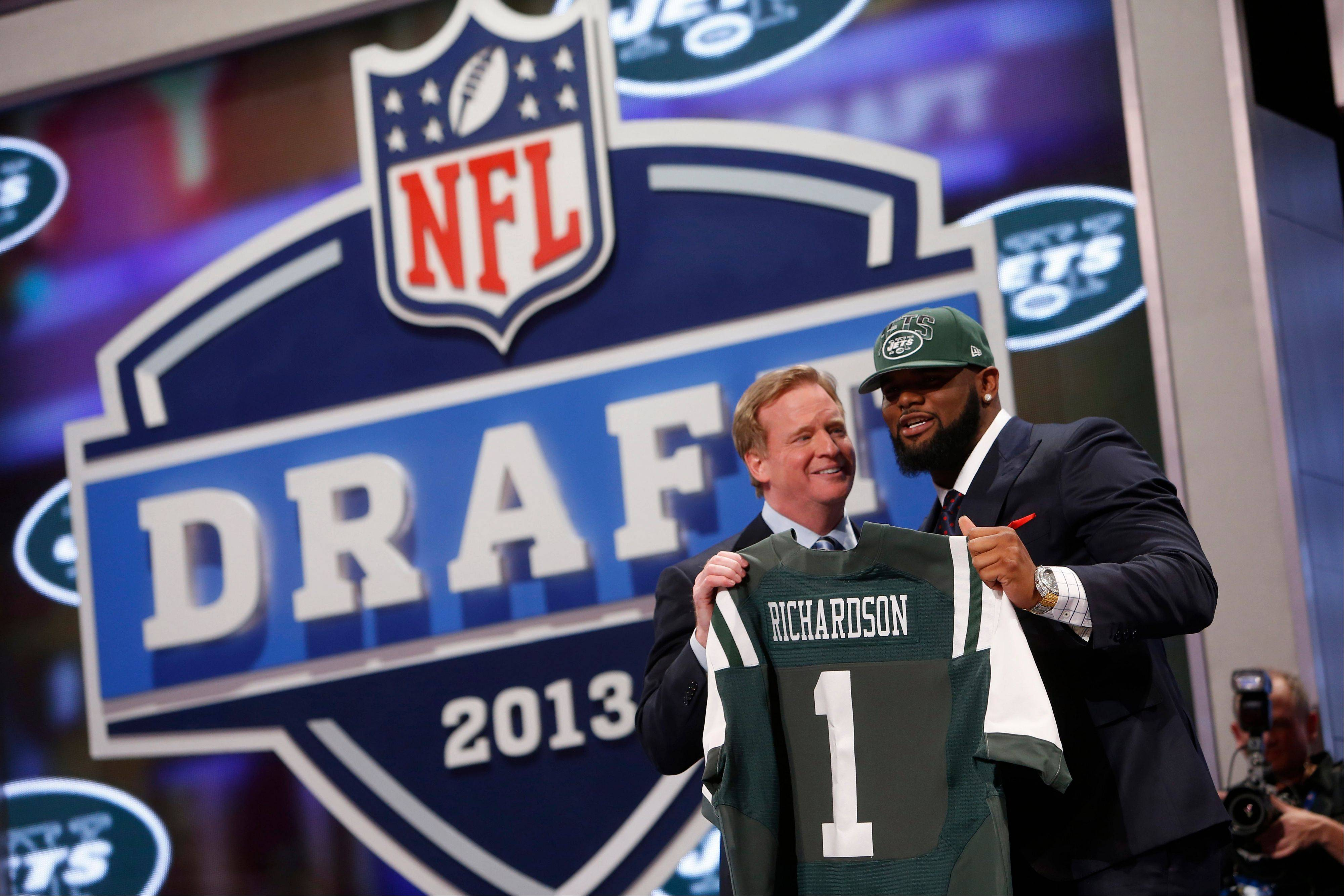 Defensive tackle Sheldon Richardson from Missouri stands with NFL commissioner Roger Goodell after being selected thirteenth overall by the New York Jets in the first round of the NFL football draft, Thursday, April 25, 2013 at Radio City Music Hall in New York.