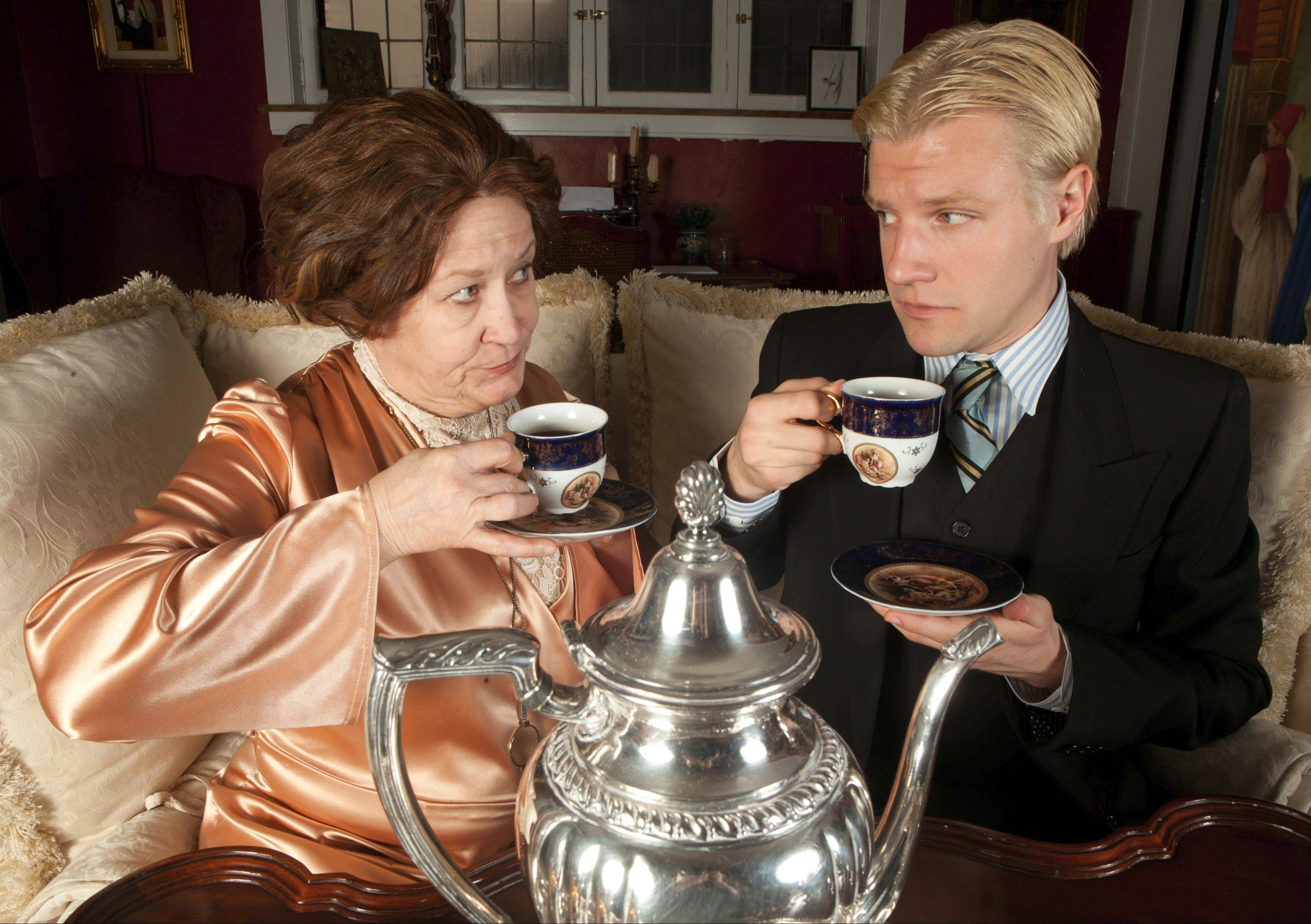 "Edith Wharton (Patti Roeder) and F. Scott Fitzgerald (Madison Niederhauser) clash in ""Tea With Edie and Fitz."" The play, by Lake Forest's Adam Pasen, is being staged by the Dead Writers Theatre Collective at Chicago's Greenhouse Theater."