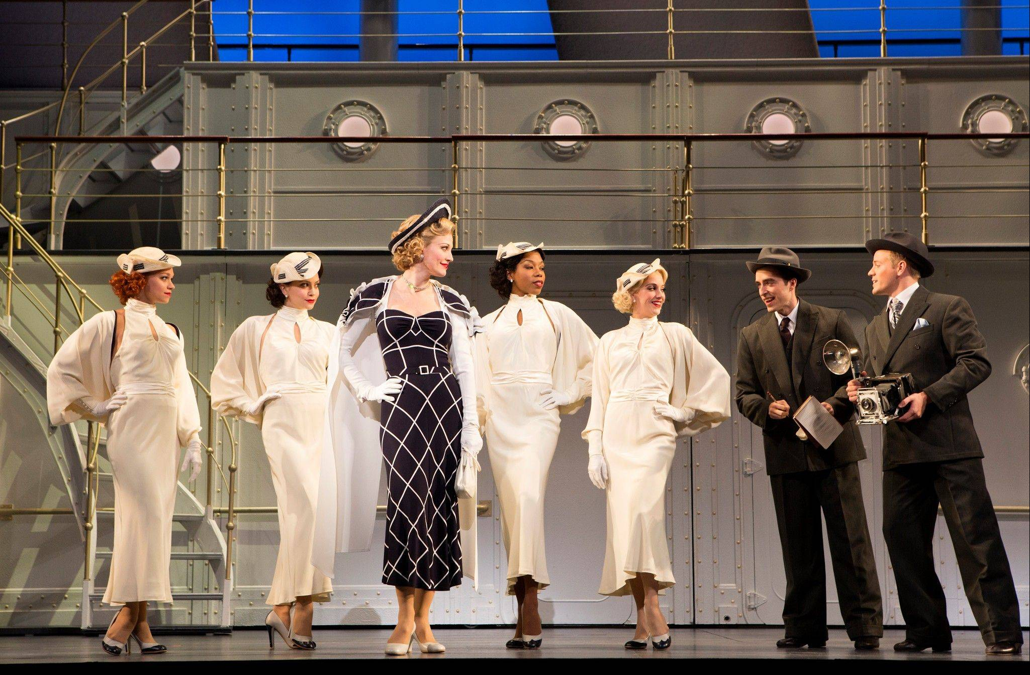 "Revivalist cabaret singer Reno Sweeney (Rachel York, center in black ensemble) is flanked by her ""Angels"" as they arrive aboard the S.S. American in the Roundabout Theatre Company's national tour of ""Anything Goes"" now at the Cadillac Palace Theatre in Chicago through Sunday, May 5."