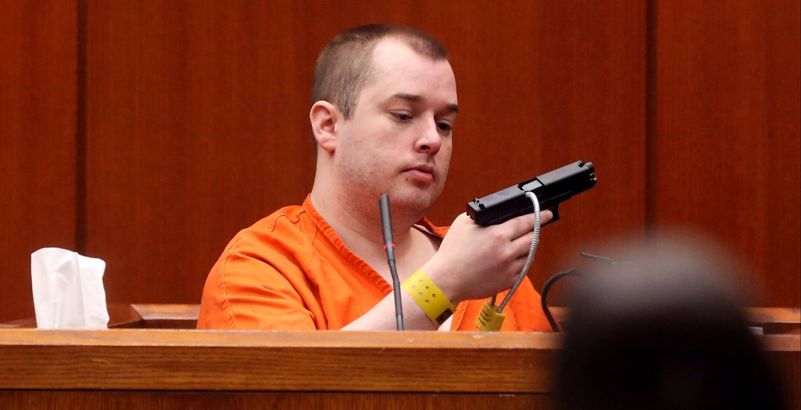 Jacob Nodarse holds the gun he used to shoot and kill Michael Kramer, 20, and Kramer's parents, Jeffrey, 50, and Lori, 48, during cross-examination in the trial of Johnny Borizov.
