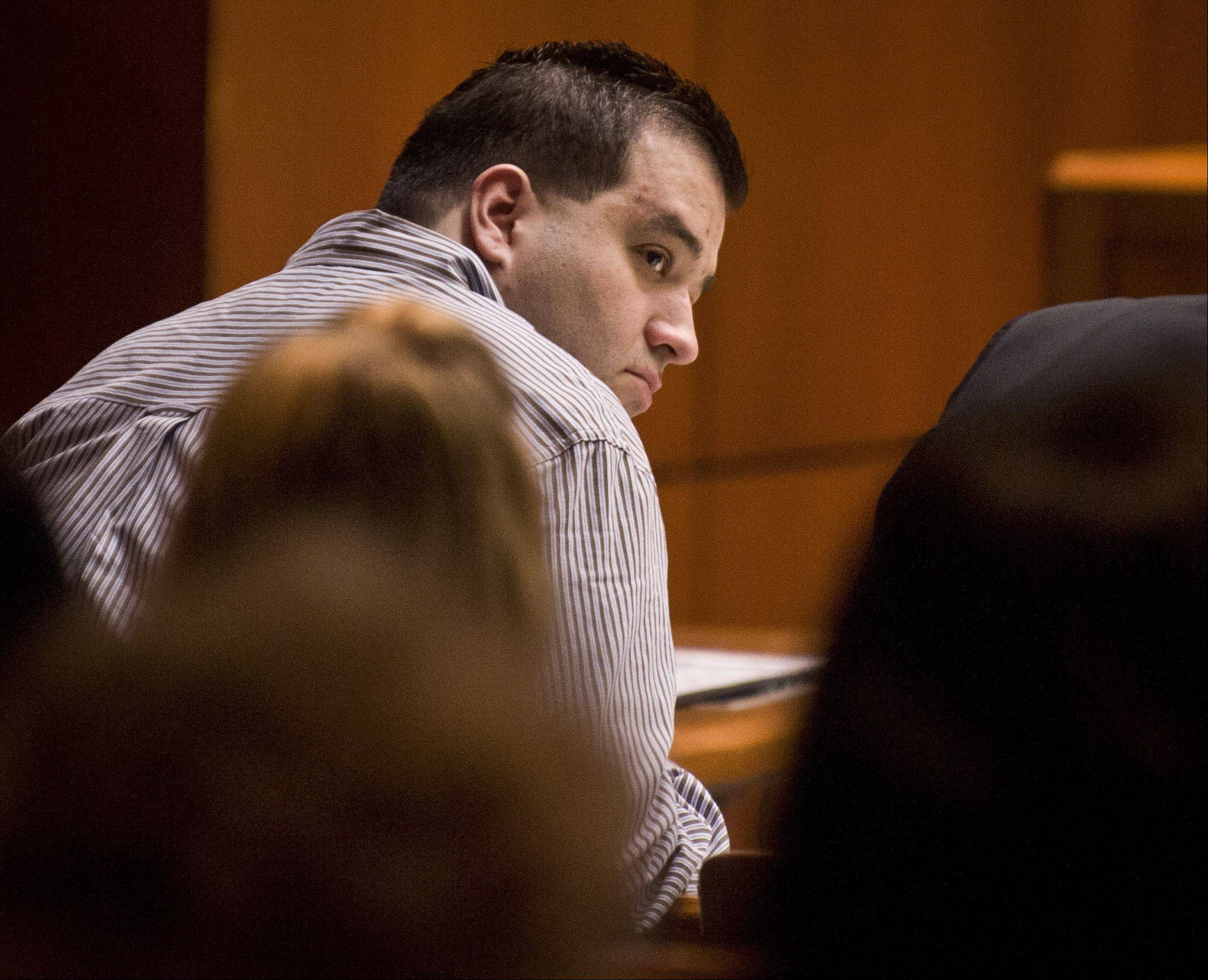 Defendant Johnny Borizov, who is being tried for first-degree murder and solicitation of murder, sits at the defense table during opening arguments at the DuPage County courthouse in Wheaton on Tuesday.
