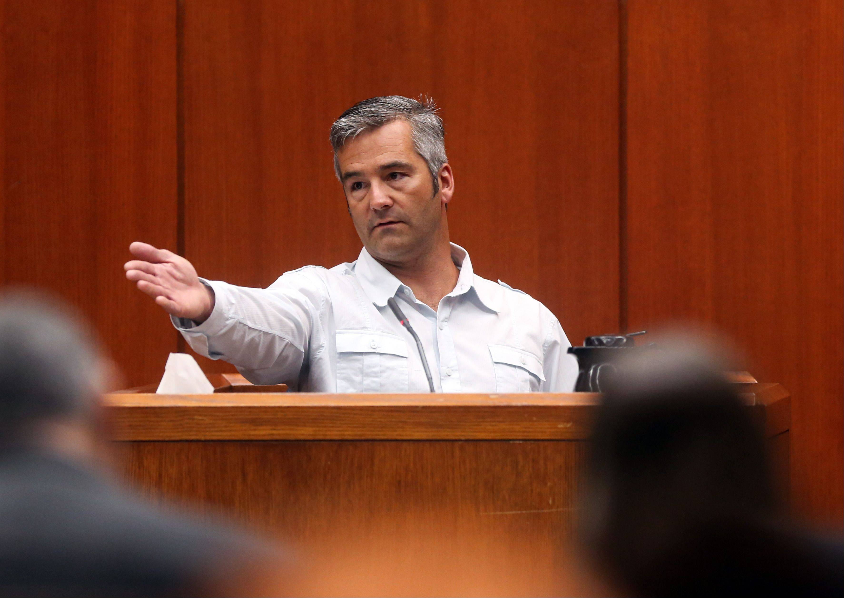 William Svatos, III, the brother of Lori Kramer, points out Johnny Borizov, who is charged with murder, conspiracy and solicitation, during Borizov's trial at the DuPage County Courthouse in Wheaton on Friday.