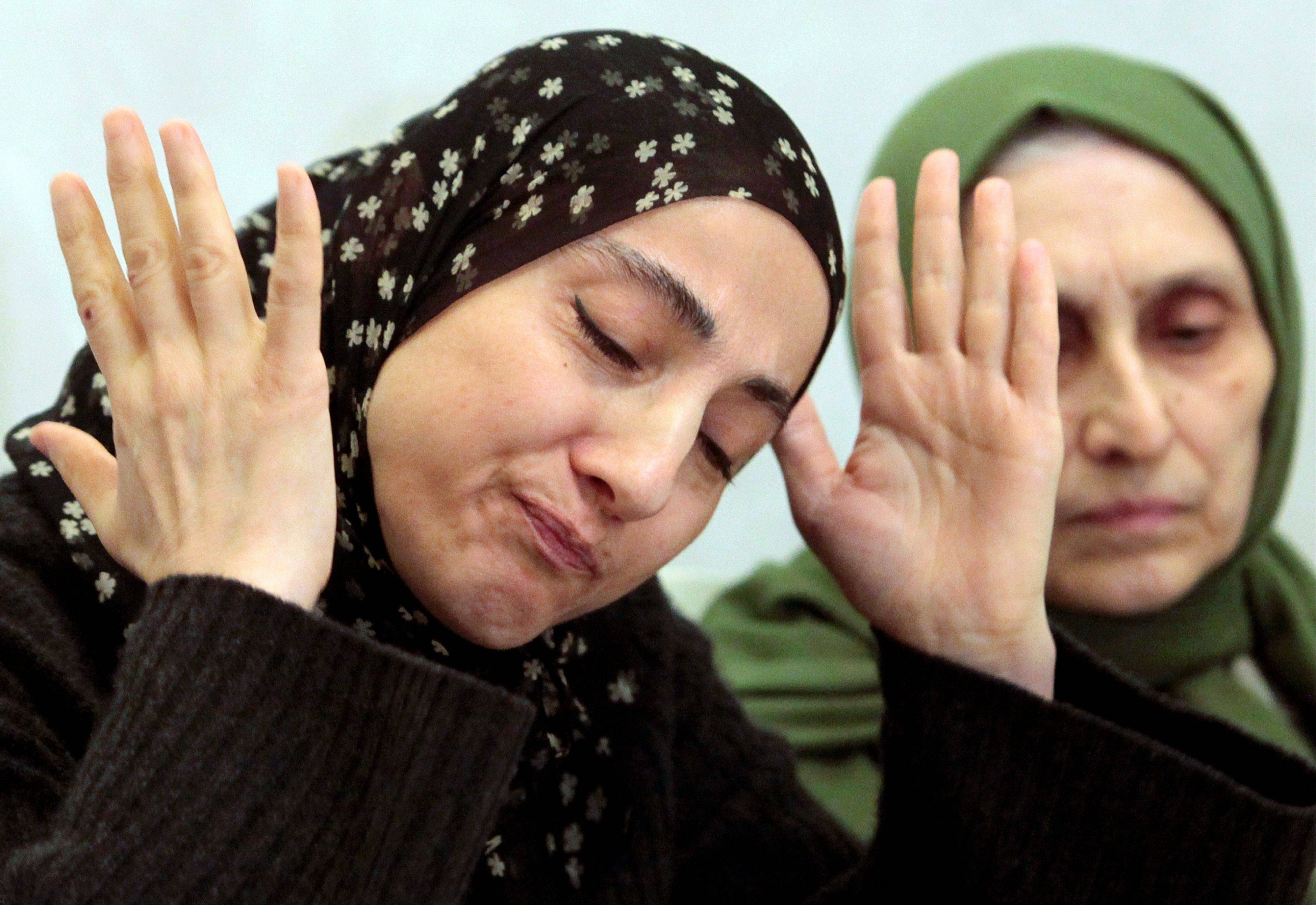 Zubeidat Tsarnaeva, the mother of the two Boston bombing suspects, speaks Thursday at a news conference as her sister-in-law, Maryam, listens in Makhachkala, in the southern Russian province of Dagestan.