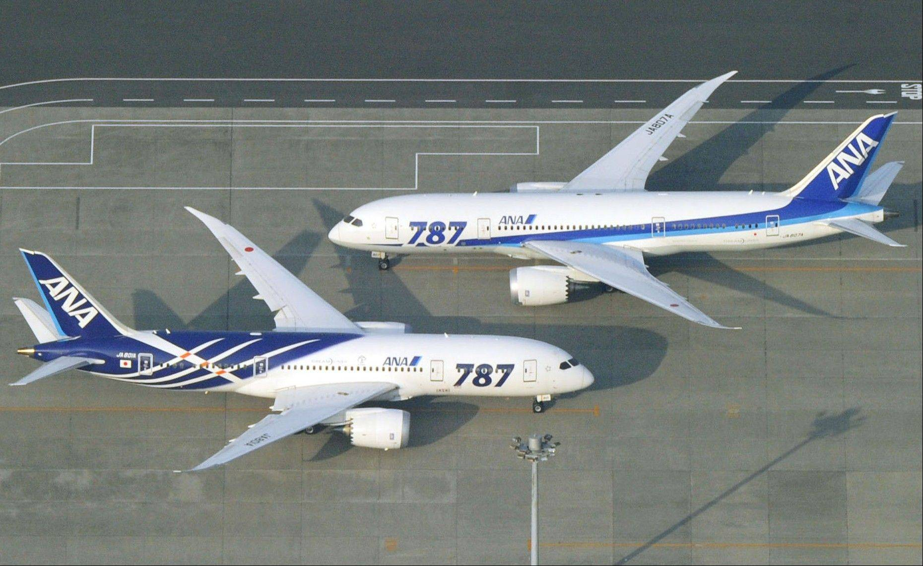 All Nippon Airways Boeing 787 planes sit Friday on a tarmac at Haneda Airport in Tokyo.