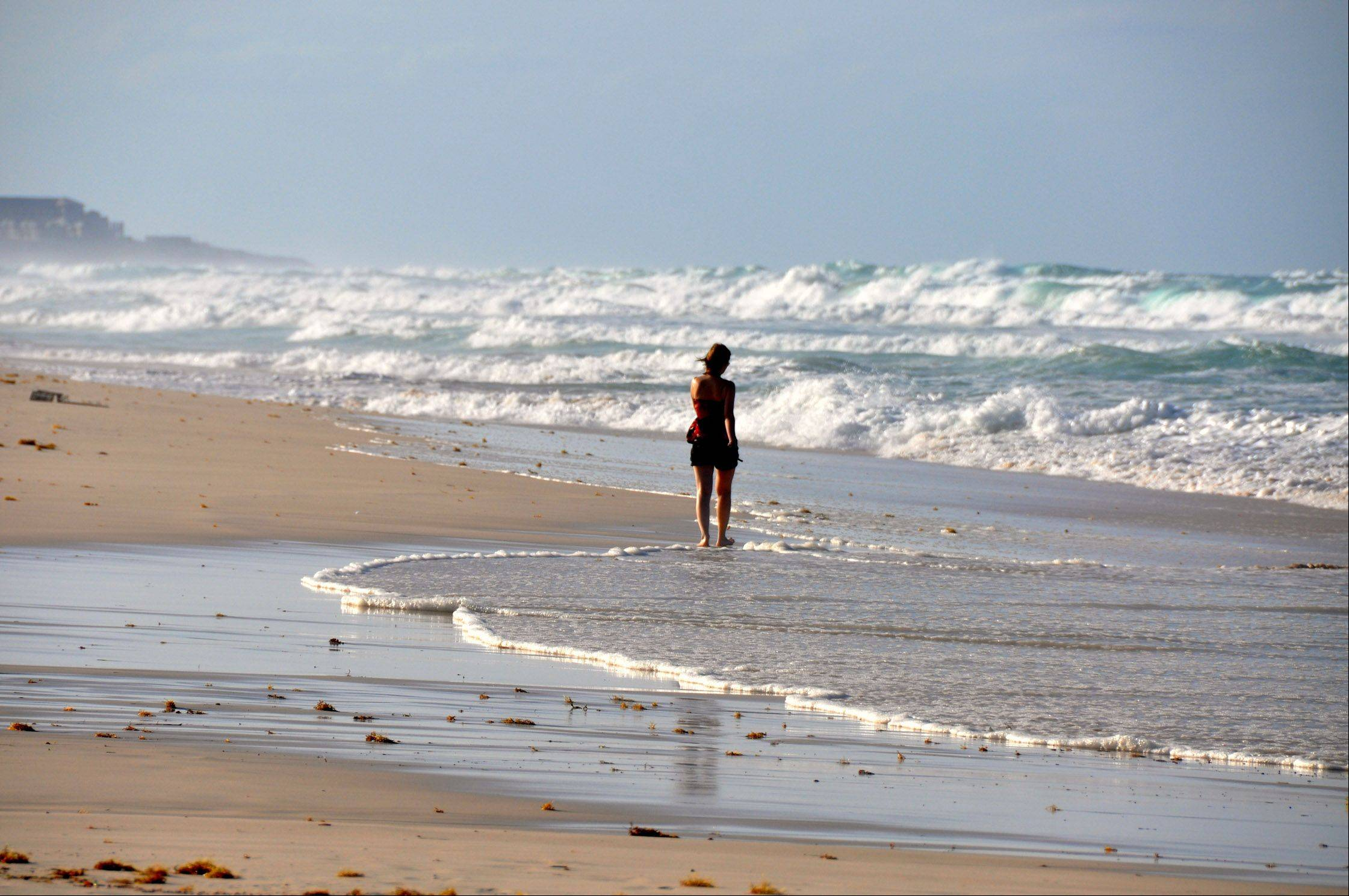 A woman walks along the beach in Puta Cana, Dominican Republic last month.